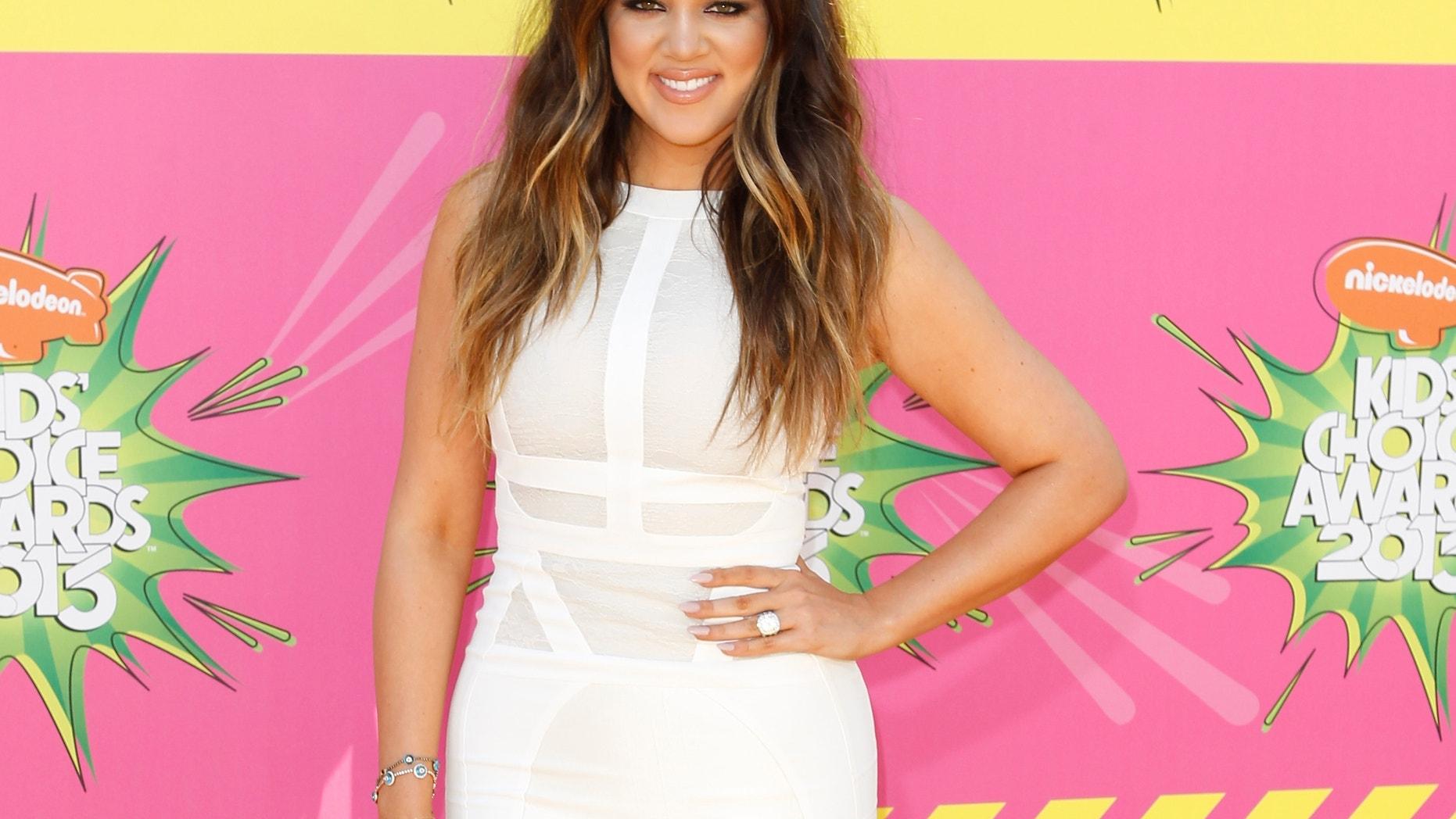 Actress Khloe Kardashian arrives at the 2013 Kids Choice Awards in Los Angeles, California March 23, 2013.