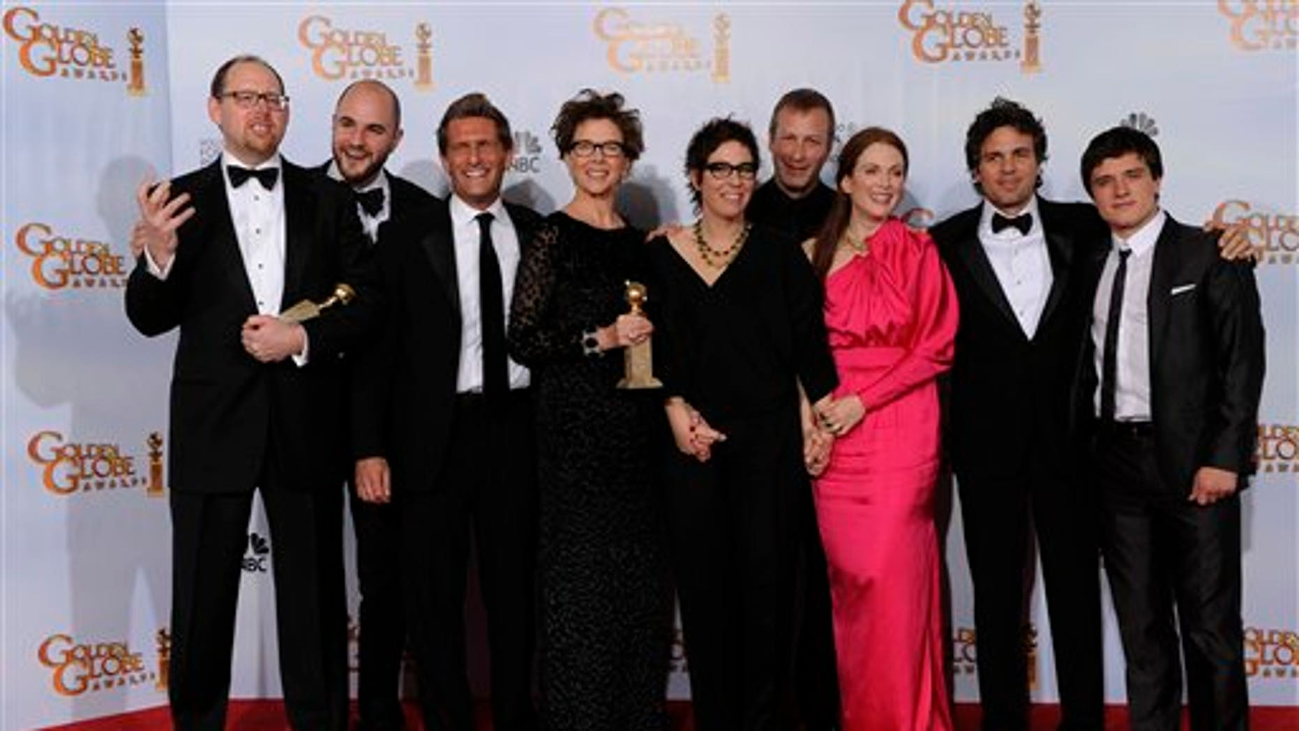 """The cast and crew of """"The Kids Are All Right,"""" pose with the award they won for Best Motion Picture - Comedy Or Musical at the Golden Globe Awards Sunday, Jan. 16, 2011, in Beverly Hills, Calif. (AP Photo/Matt J. Terrill)"""