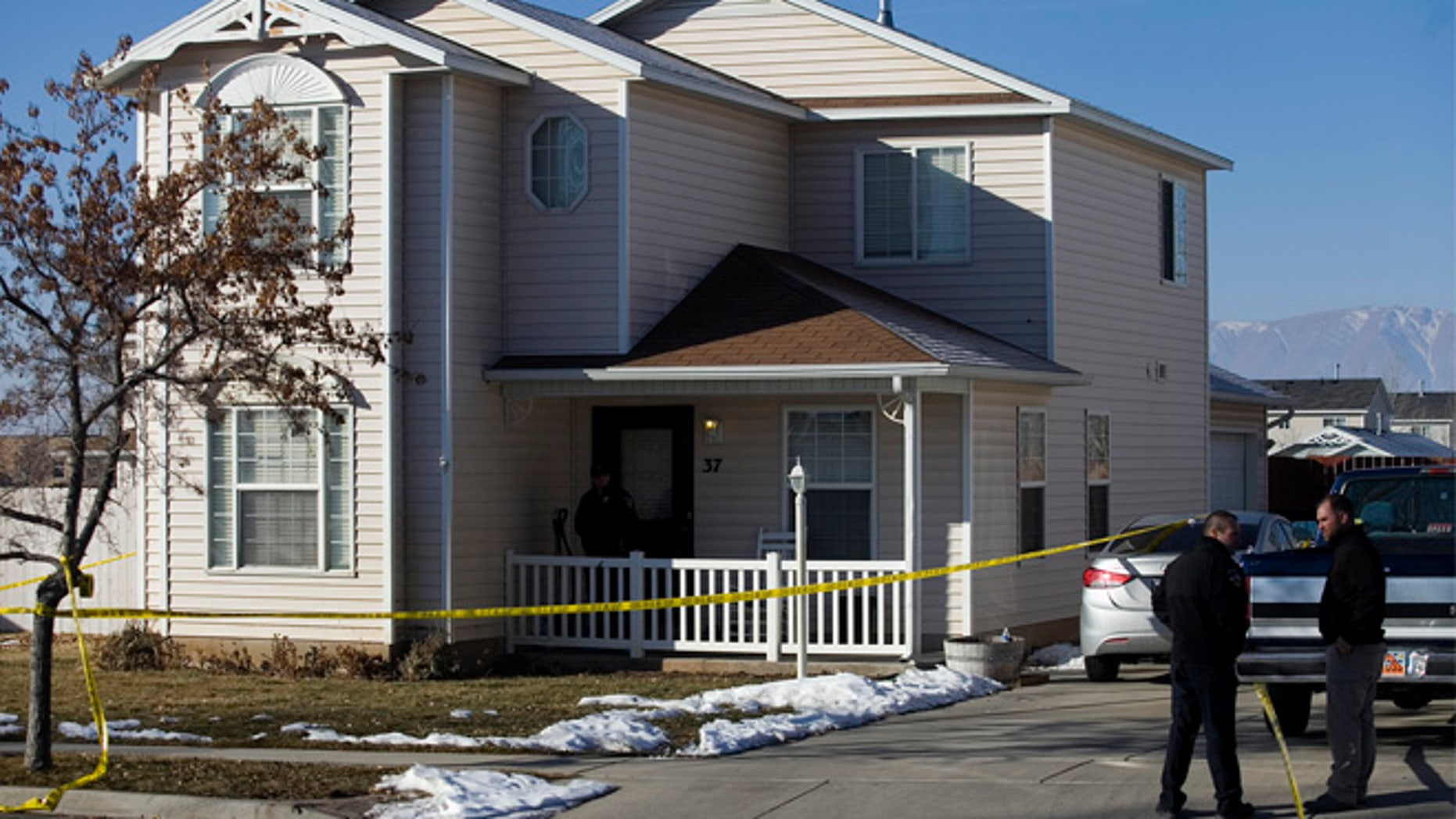 Jan. 17: Investigators put police tape in front of a home in Spanish Fork, Utah, where five people were found dead on Thursday.