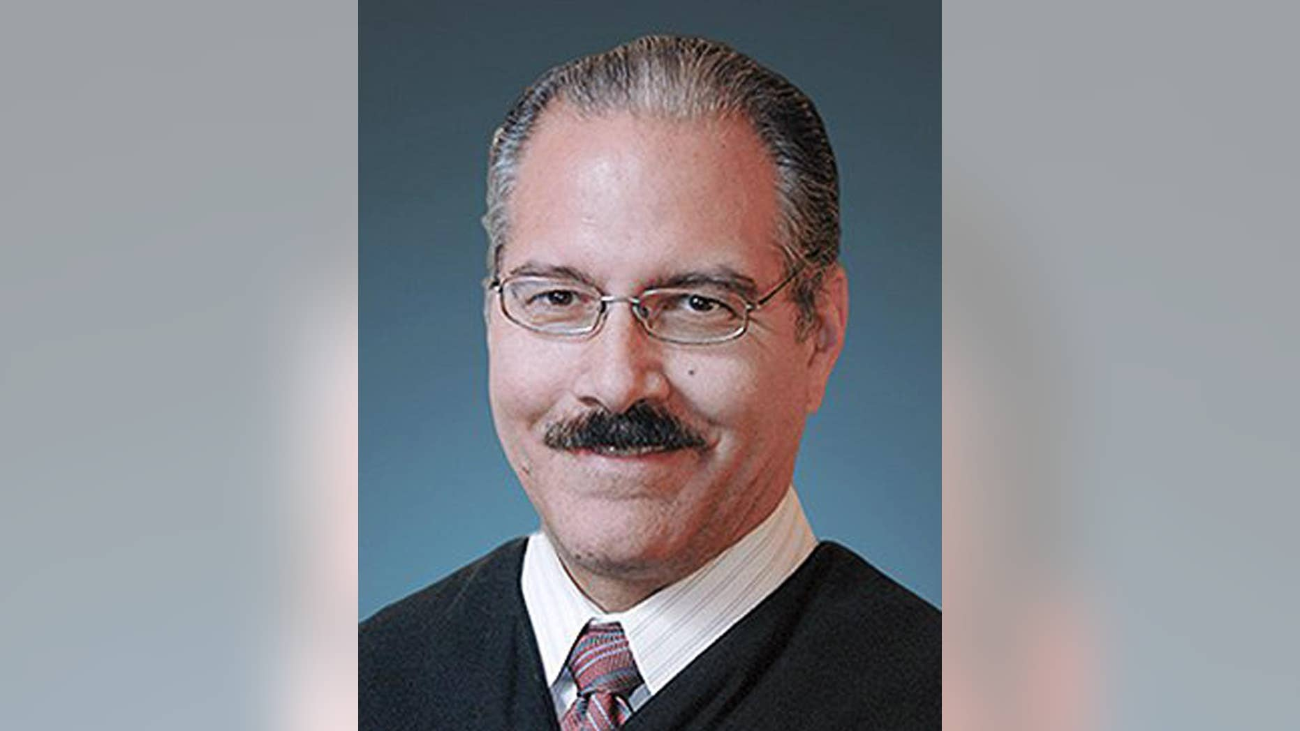 This photo provided by the Tulsa County District Court shows District Judge James Caputo. Caputo, who is assigned to the case of a volunteer deputy accused of manslaughter in the shooting of a restrained suspect, said in a court filing Wednesday, April 22, 2015 that he is considering whether to recuse himself due to his close ties to the Tulsa, Oklahoma, sheriff's office. (Tulsa County District Court via AP)