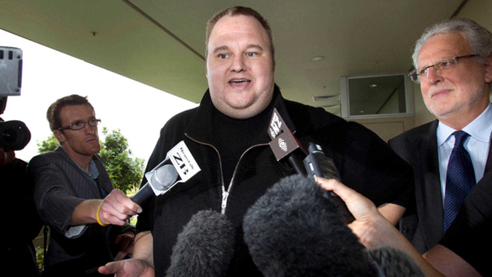 Feb. 22, 2012: Kim Dotcom, the founder of the file-sharing website Megaupload, comments after he was granted bail and released in Auckland, New Zealand.  In a move bound to provoke U.S. prosecutors and entertainment executives, Dotcom is planning to offer a new online music service and a replacement of his shuttered website by years end.