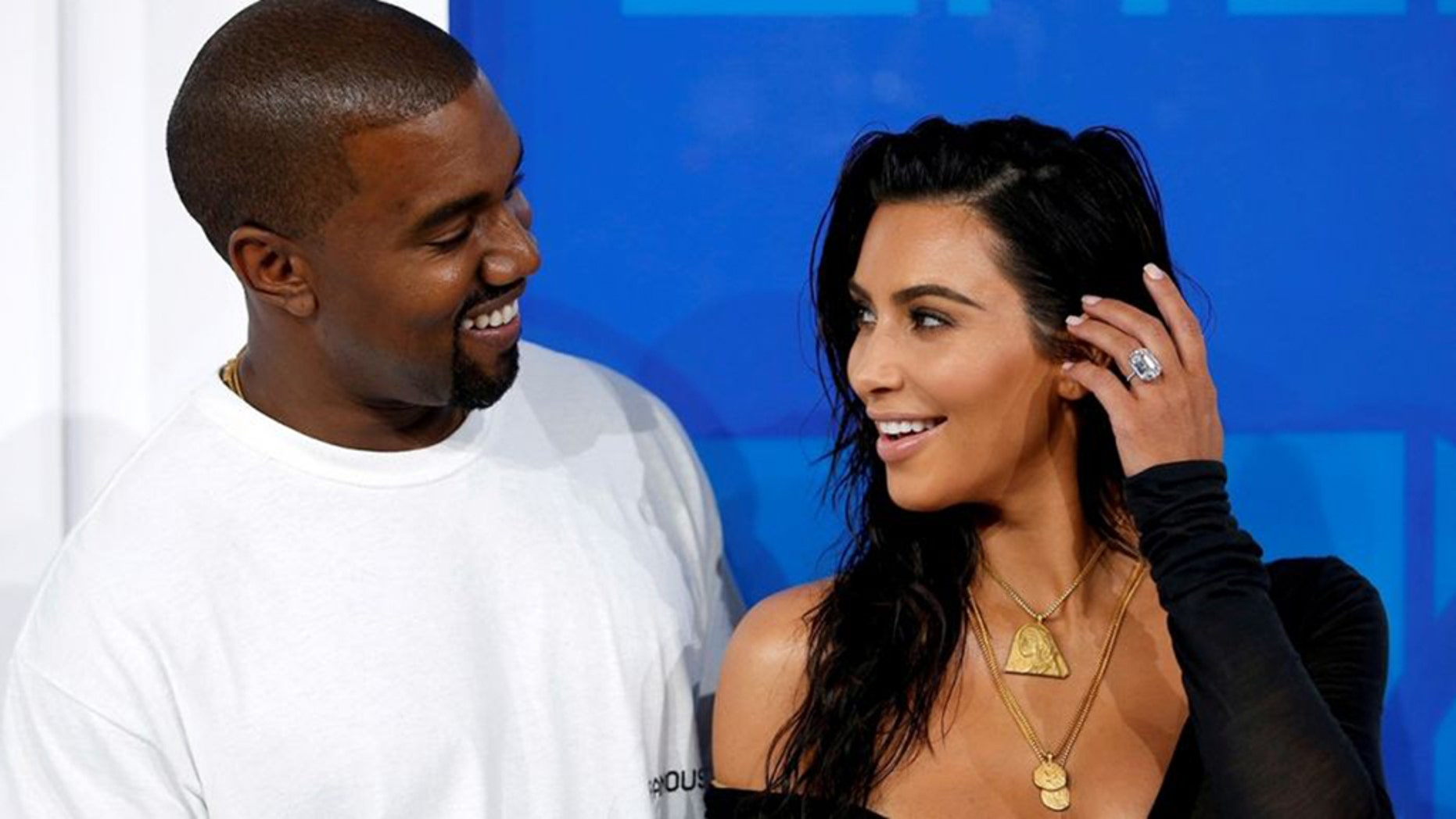 Paul McCartney said Kanye West would look at photos of Kim Kardashian while writing songs.