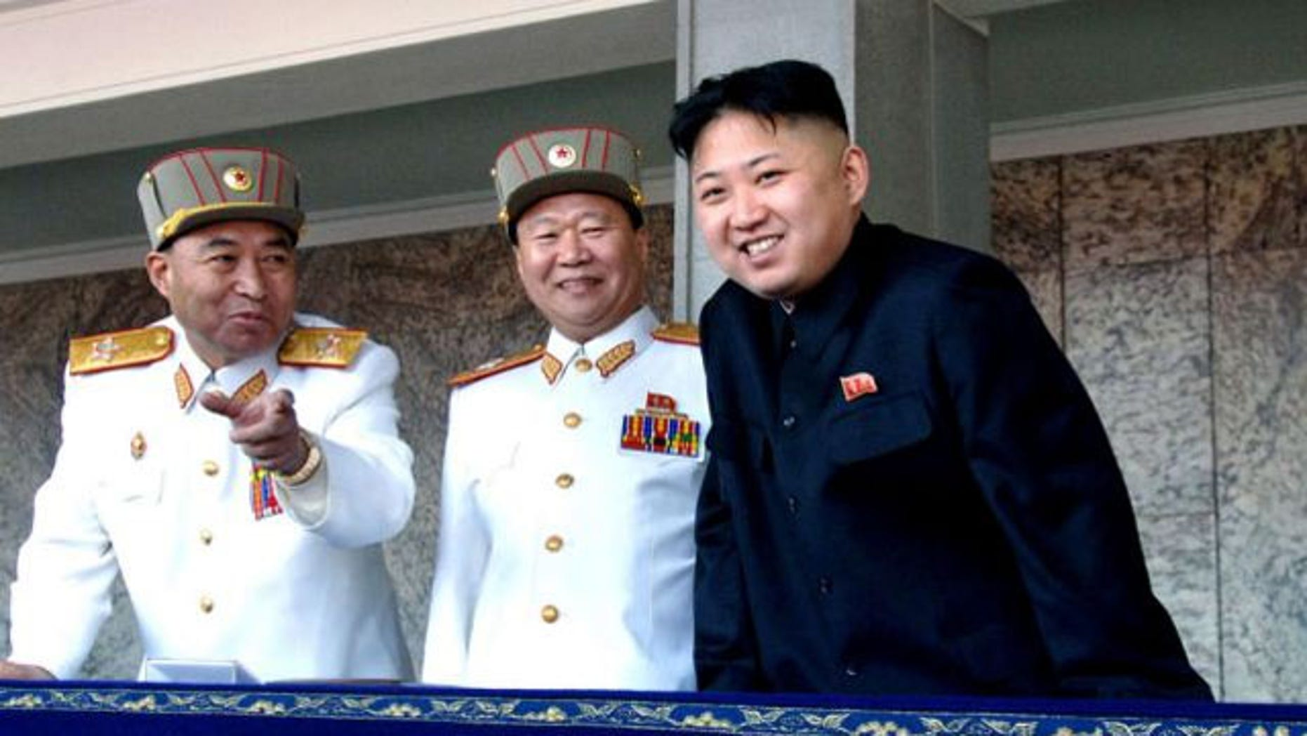 April 15, 2012: Kim Jong-un (right), smiles with Vice Marshal and Vice Chairman of the Central Military Commission Choe Ryong-hae (center) and Vice Marshal and the military's General Staff Chief Ri Yong-ho (AP)