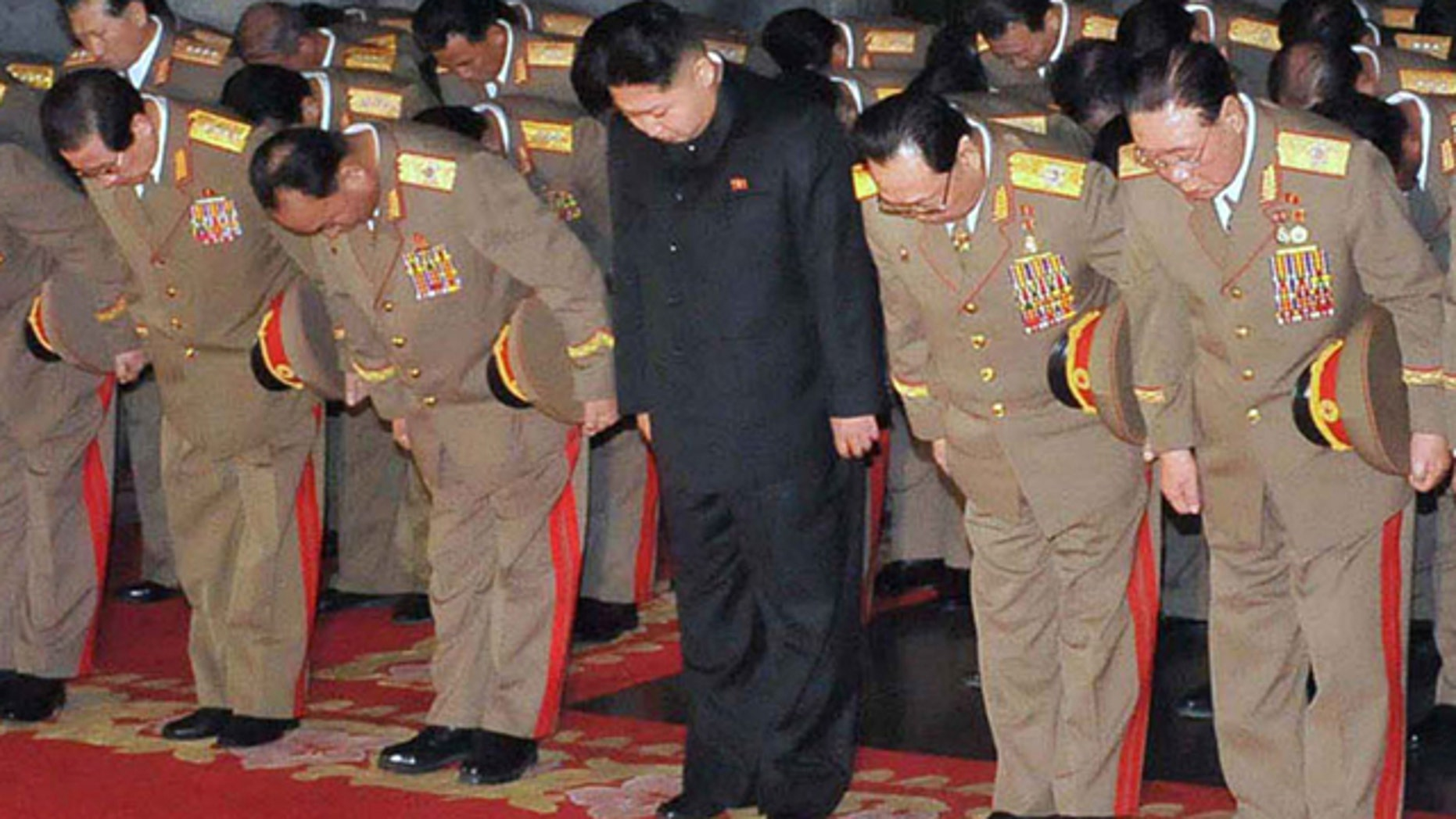 Dec. 24, 2011: This photo released by the Korean Central News Agency and distributed by the Korea News Service, shows Kim Jong Un, center.