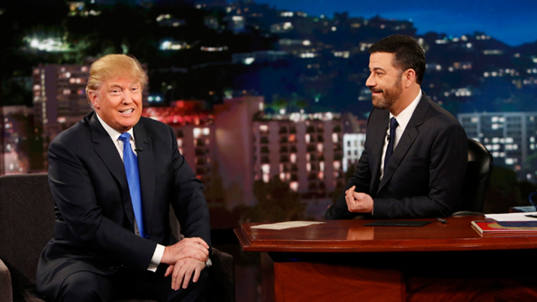 This photo provided by ABC shows guest Republican Presidential candidate Donald Trump, left, with host Jimmy Kimmel, on Jimmy Kimmel Live on Wednesday, Dec. 16, 2015, in Los Angeles. The ABC show airs every weeknight, 11:35 p.m. - 12:41 a.m., ET. (Randy Holmes/ABC via AP)