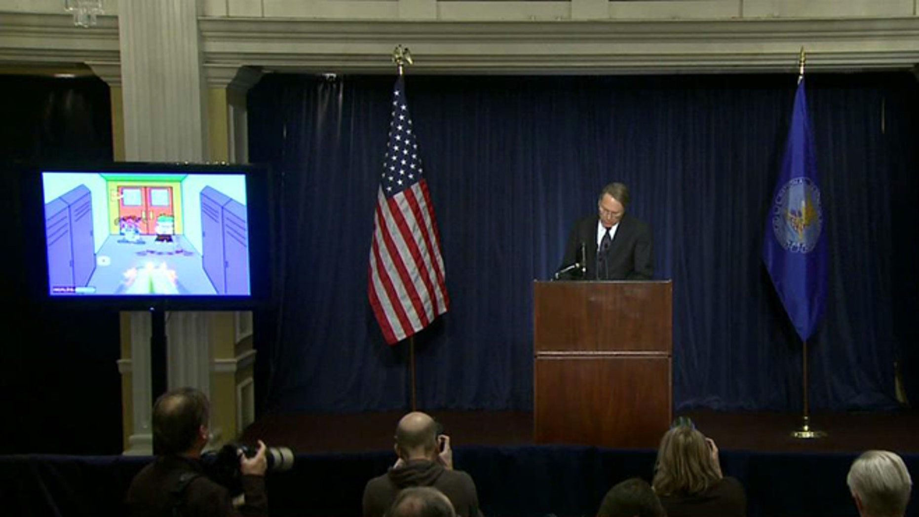 """Dec. 22, 2012: Citing violent video games such as """"Kindergarten Killers,"""" seen on a screen over his shoulder, NRA chief Wayne LaPierre addresses the nation following a massacre in Connecticut."""