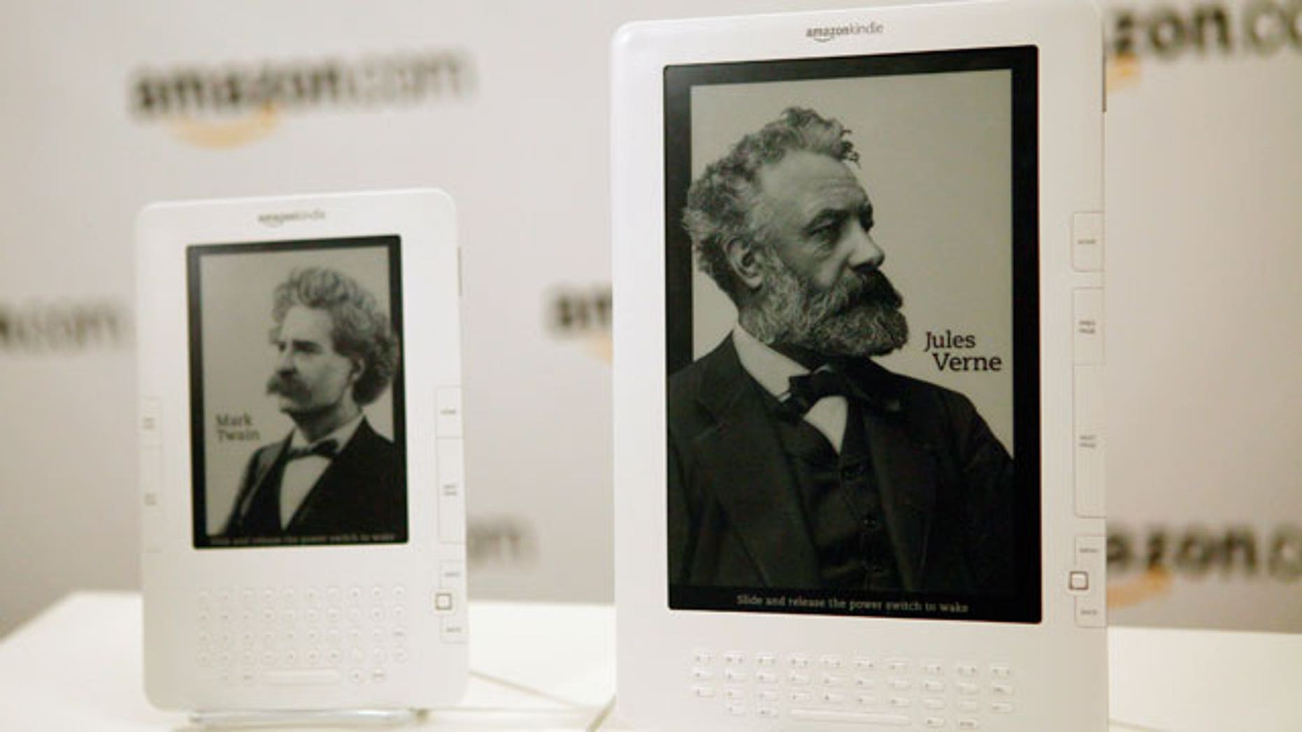 Two models of the Amazon Kindle stand side by side on display.