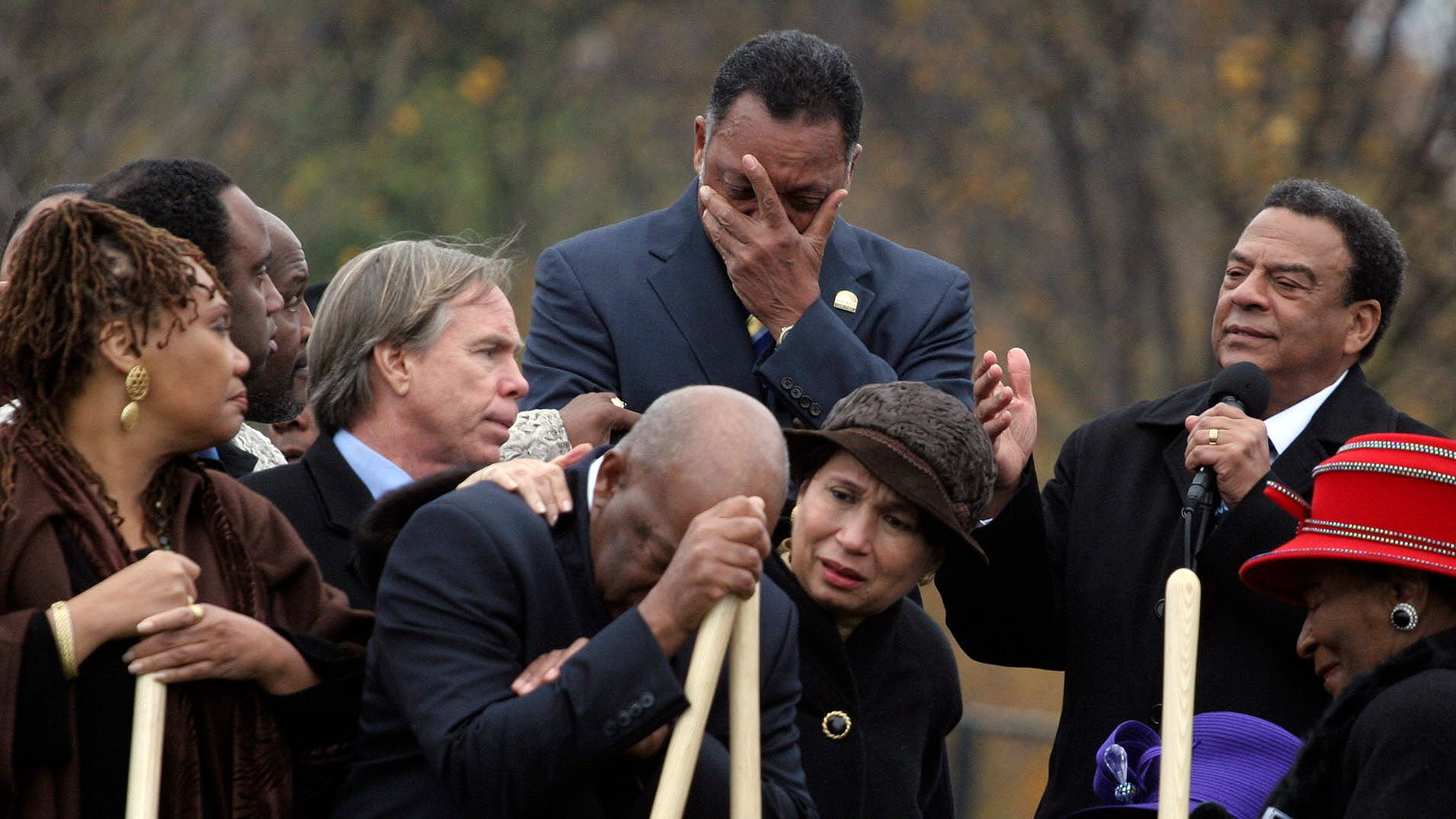 November 13, 2006: Rev. Jesse Jackson, top center, Rep. John Lewis, D-Ga., leaning on shovel, becoming emotional as Amb. Andrew Young, top right, speaks about the significance of the late Dr. Martin Luther King Jr., during the breaking ground for the Martin Luther King Memorial on the National Mall in Washington. This week, the trio, along with the Rev. Joseph Lowery and many other lesser known soldiers who worked alongside King in the struggle for justice and equality will come together again, to dedicate the monument built in his honor.