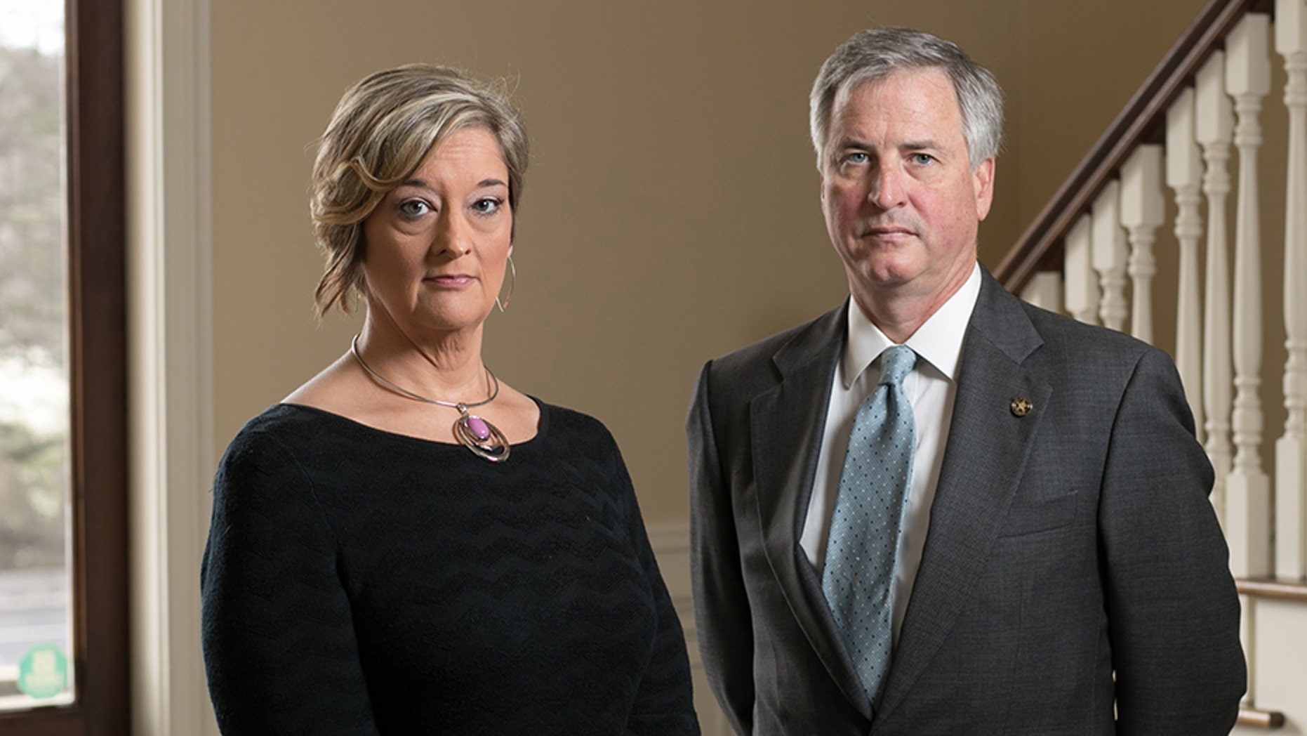 Anne King, of Tennille, Ga., is shown with her lawyer Ken Hodges at Hodges' law office Thursday, March 1, 2018, in Atlanta. King is suing her ex-husband.
