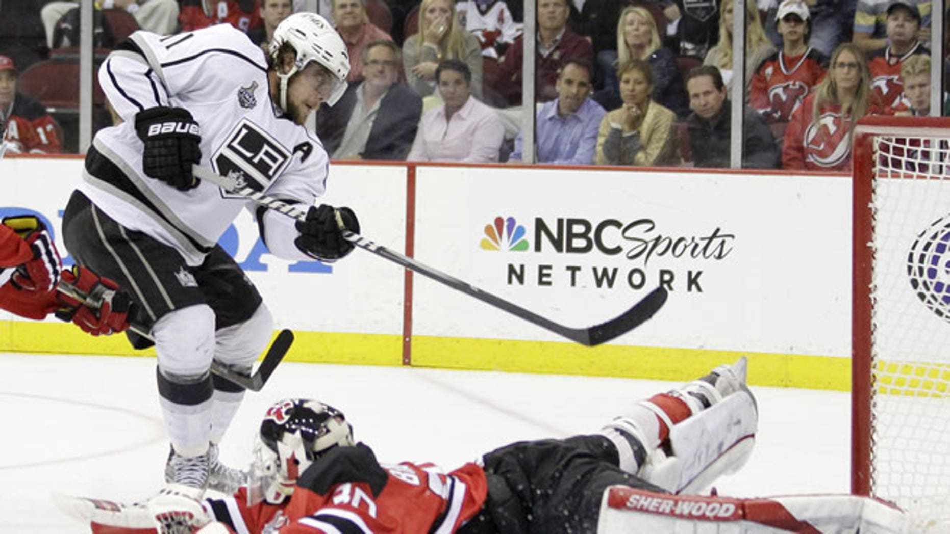 May 30, 2012: Los Angeles Kings' Anze Kopitar, of Slovenia, scores past New Jersey Devils' Martin Brodeur during overtime in Game 1 of the NHL hockey Stanley Cup finals in Newark, N.J. The Kings won 2-1.