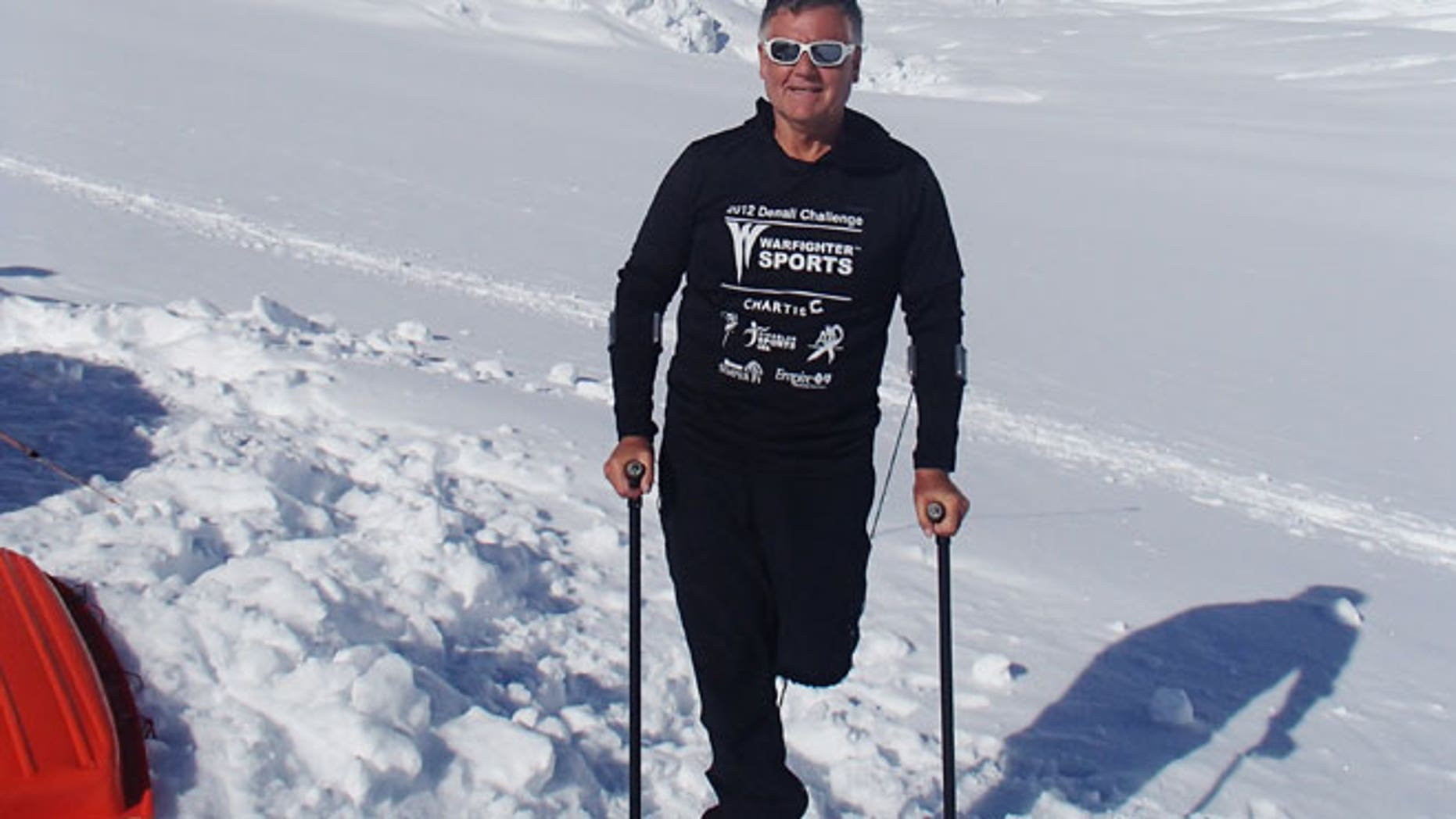 In this June 13, 2012 photo released by Disabled Sports USA, shows Kirk Bauer, 64, a climber and executive director of Disabled Sports USA, poses in front of Mount McKinley, Alaska.