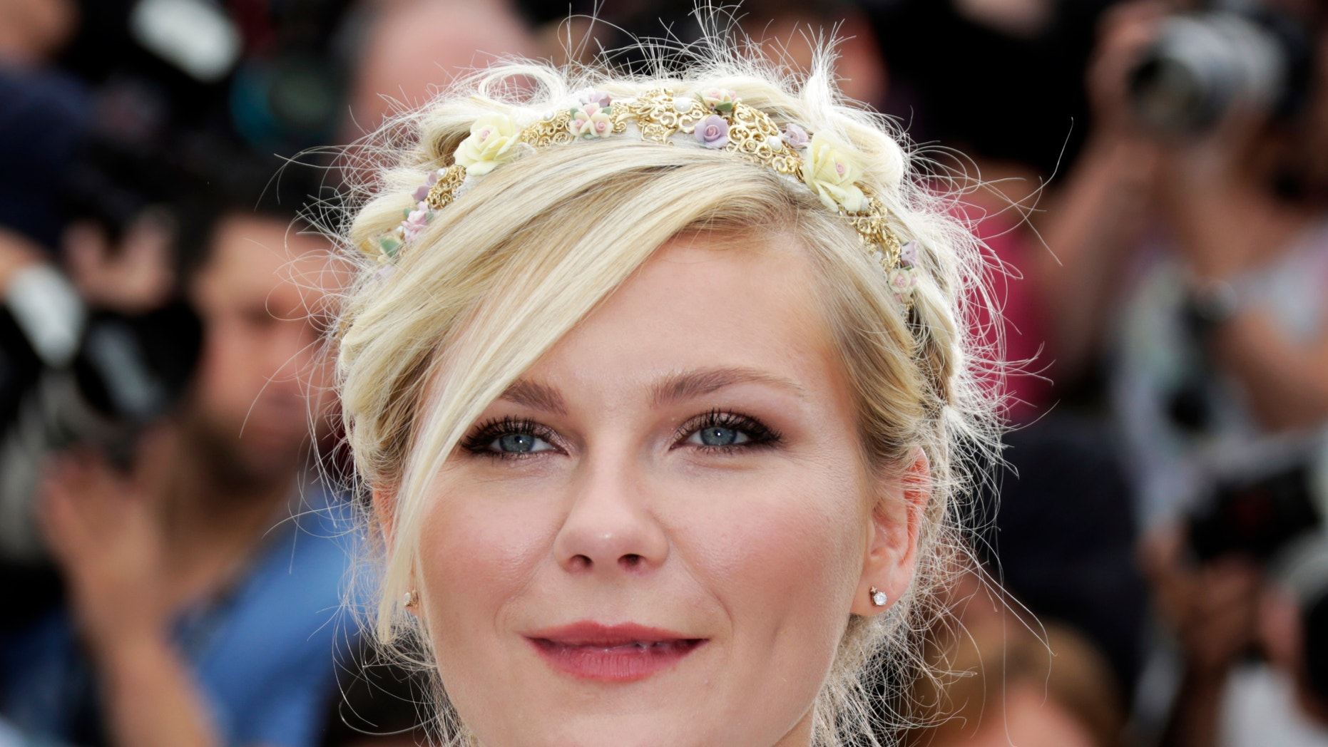 """Cast member Kirsten Dunst poses during a photocall for the film """"On The Road"""", in competition at the 65th Cannes Film Festival, May 23, 2012."""