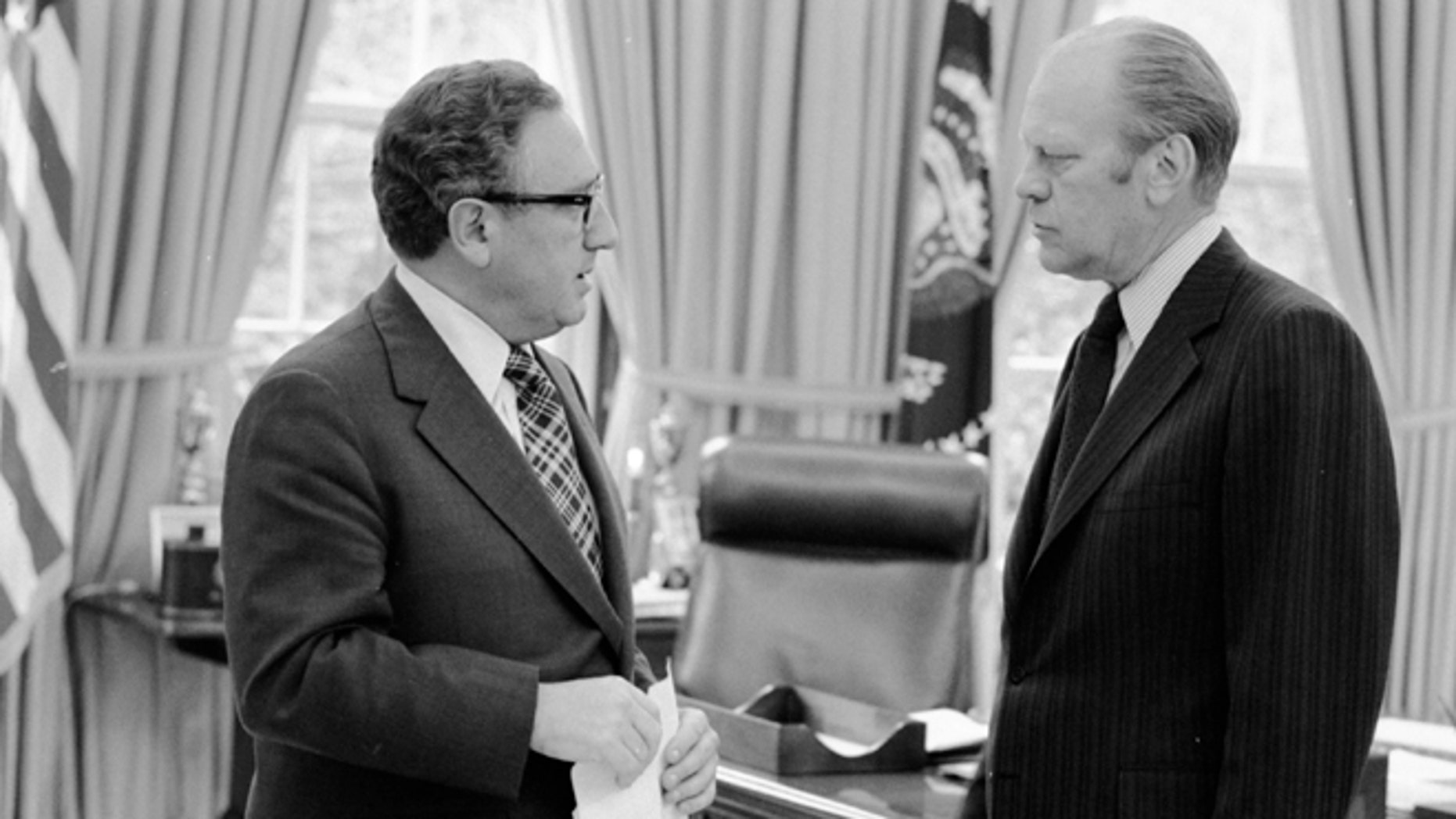 """This April 29, 1975 photo provided by courtesy of American Experience and the Gerald R. Ford Presidential Library shows, President Gerald R. Ford, right, and Secretary of  State Henry A. Kissinger during the evacuation of Saigon in South Vietnam. The new documentary film, """"Last  Days in Vietnam,"""" directed and produced by Rory Kennedy, recounts the dramatic events surrounding the 1975 military evacuation of Saigon during the Vietnam War. The film releases on Friday, Sept. 5, 2014. (AP Photo/Courtesy of American Experience, Gerald R. Ford Presidential Library)"""