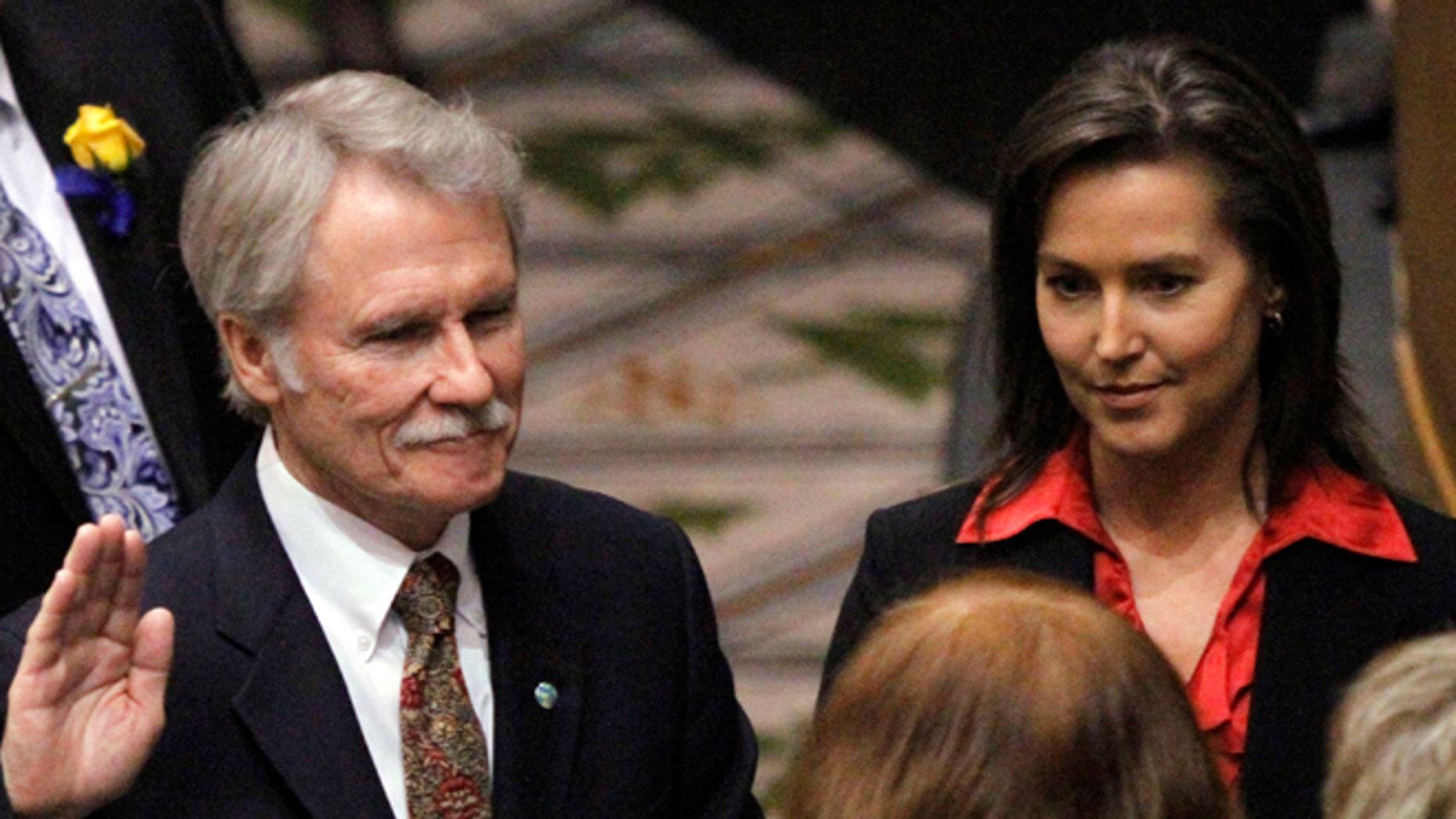 FILE: Jan. 10, 2011: Oregon Gov. John Kitzhaber, Democrat, is sworn in with financee Cylvia Hayes at his side. Salem, Oregon.