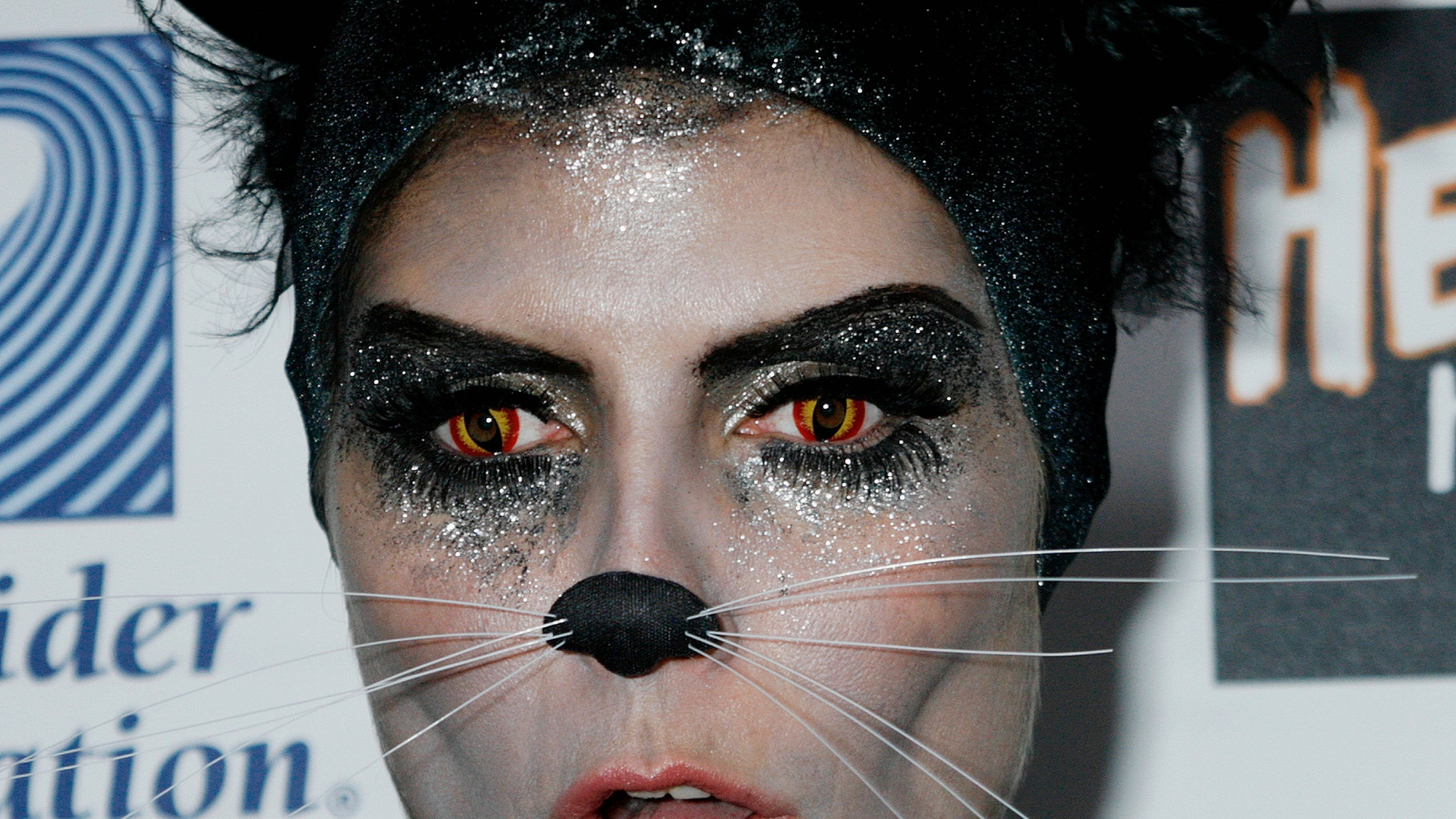 dfb7b8b2ae Heidi Klum wears a cat costume with special contact lenses to change her eye  color at
