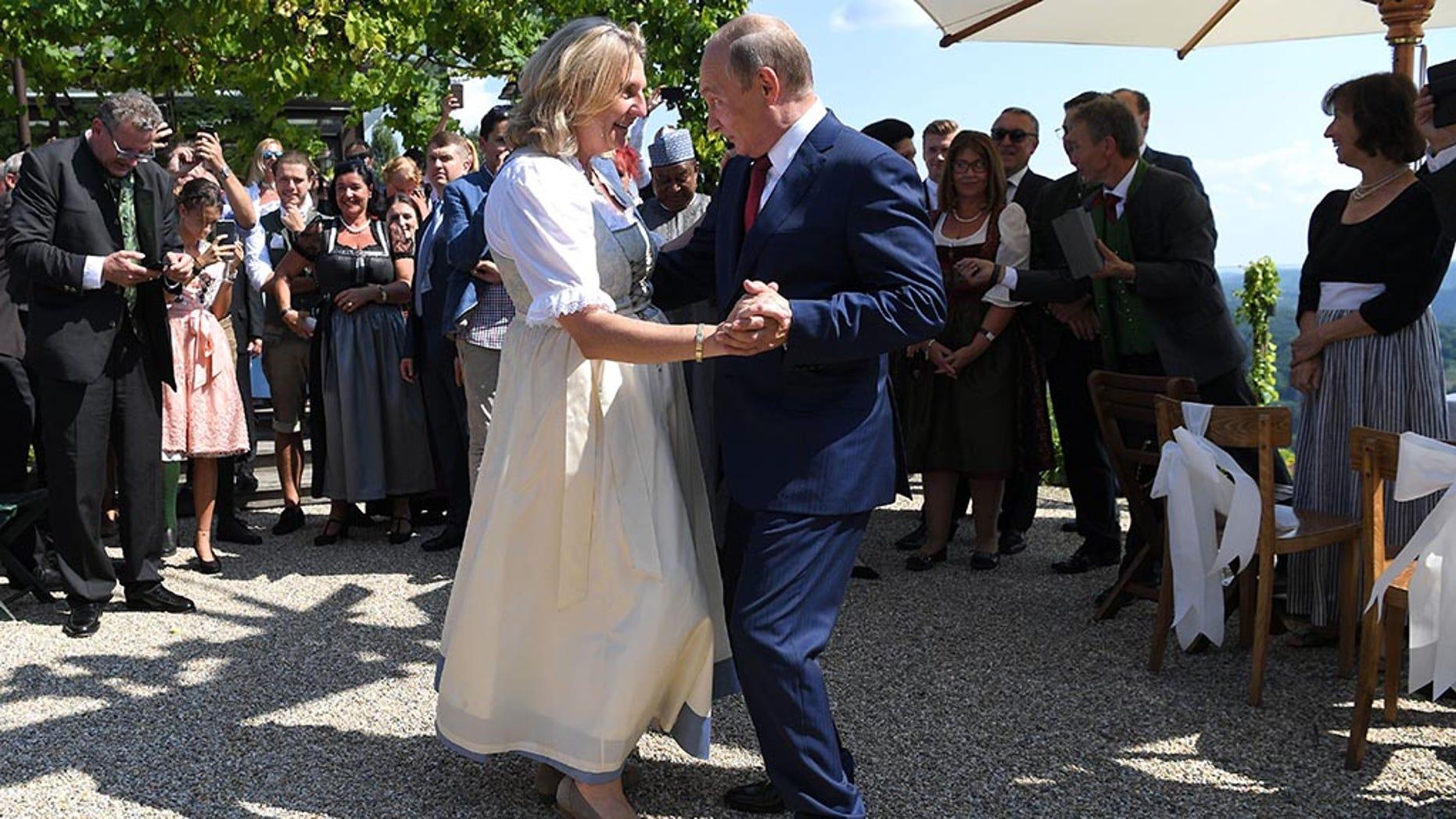 Austria's Foreign Minister Karin Kneissl dances with Russia's President Vladimir Putin at her wedding in Gamlitz, Austria, August 18, 2018. Roland Schlager/Pool via Reuters