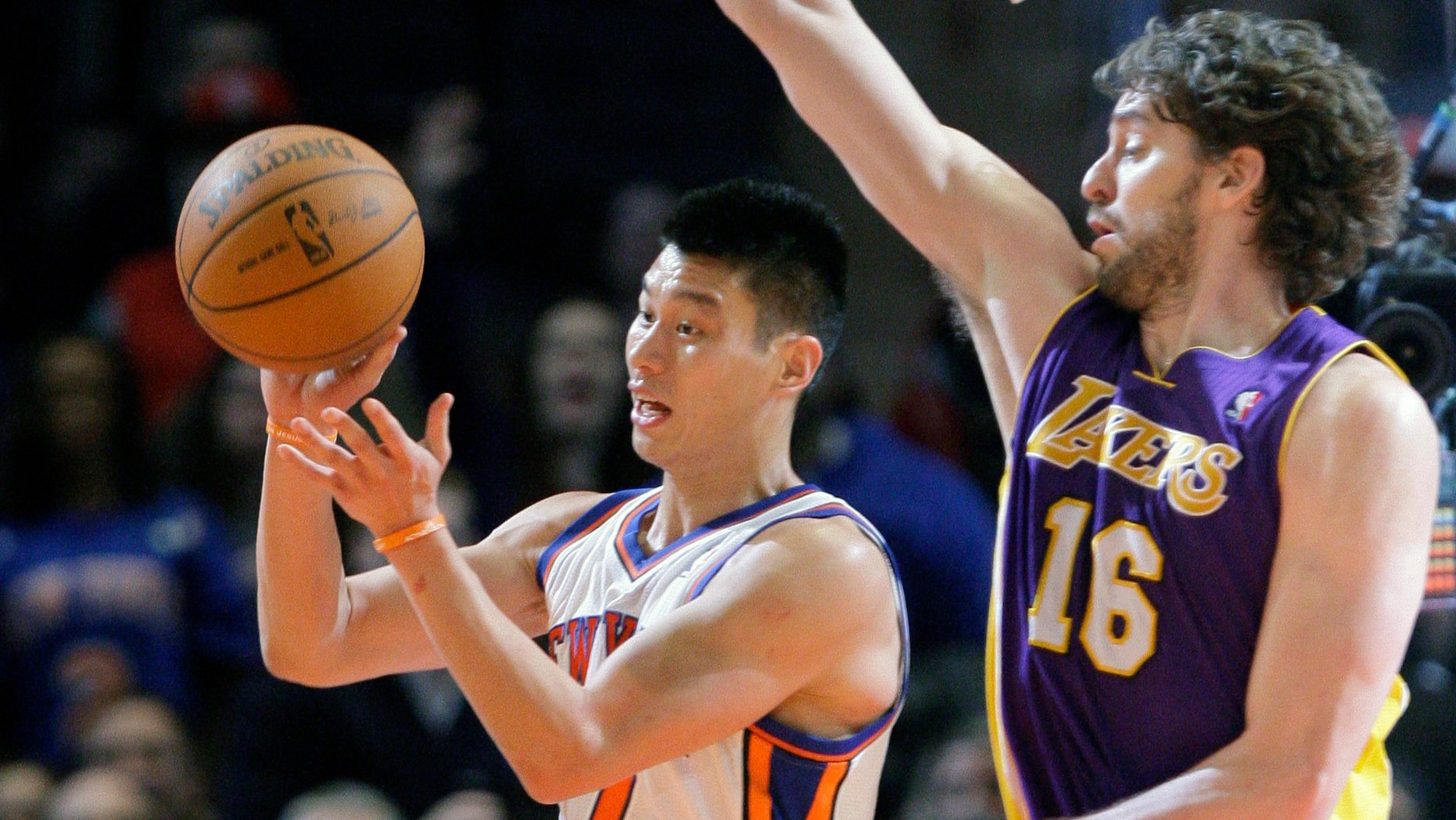 New York Knicks' Jeremy Lin (17) passes away from Los Angeles Lakers' Pau Gasol (16), of Spain, during the second half of an NBA basketball game Friday, Feb. 10, 2012, in New York. The Knicks won the game 92-85. (AP Photo/Frank Franklin II)
