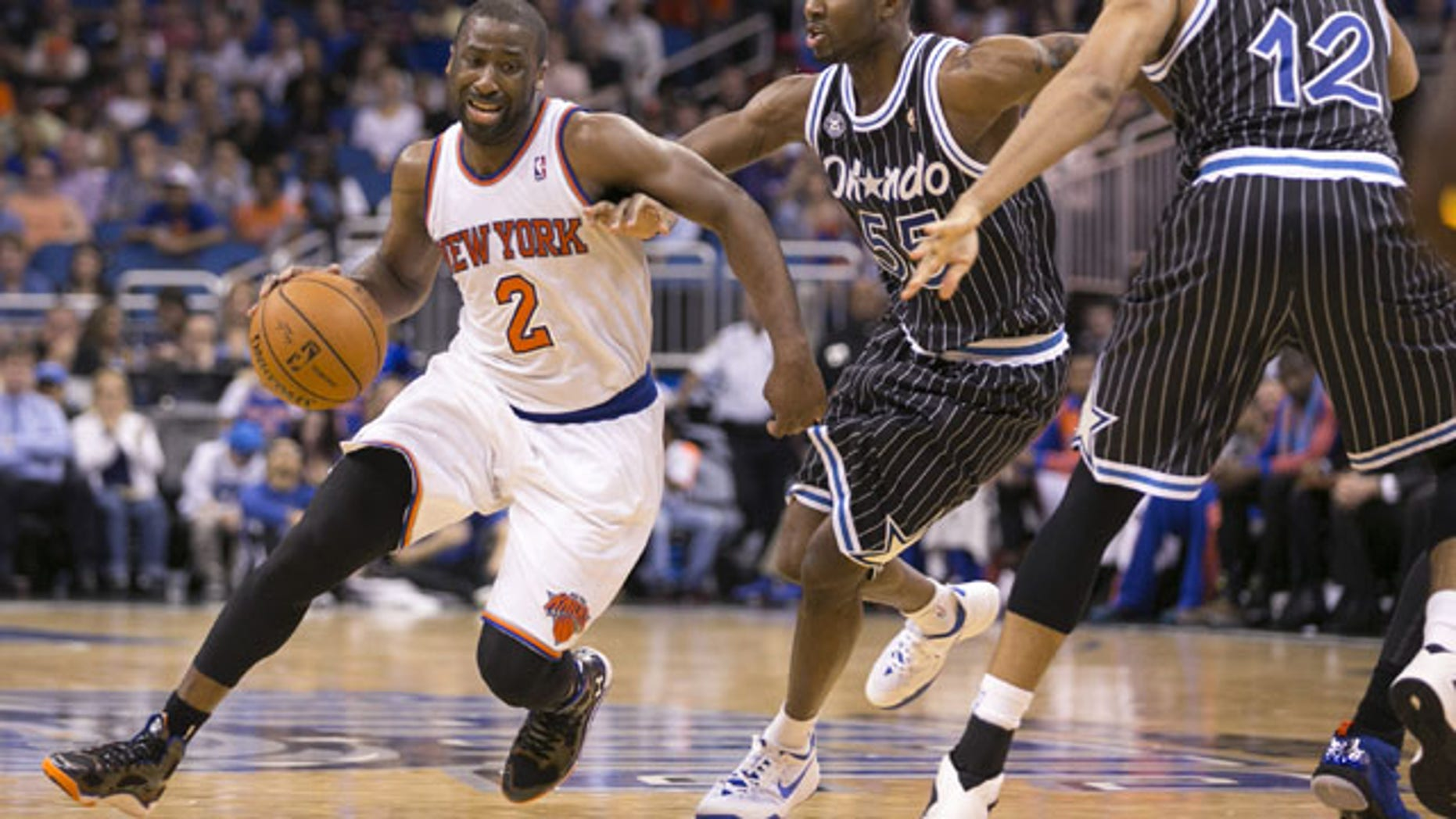 February 21, 2014: New York Knicks' Raymond Felton (2) dribbles around Orlando Magic's E'Twaun Moore (55) and Tobias Harris (12) during an NBA basketball game in Orlando, Fla. The Magic won 129-121 in two overtimes. (AP Photos/Willie J. Allen Jr.)