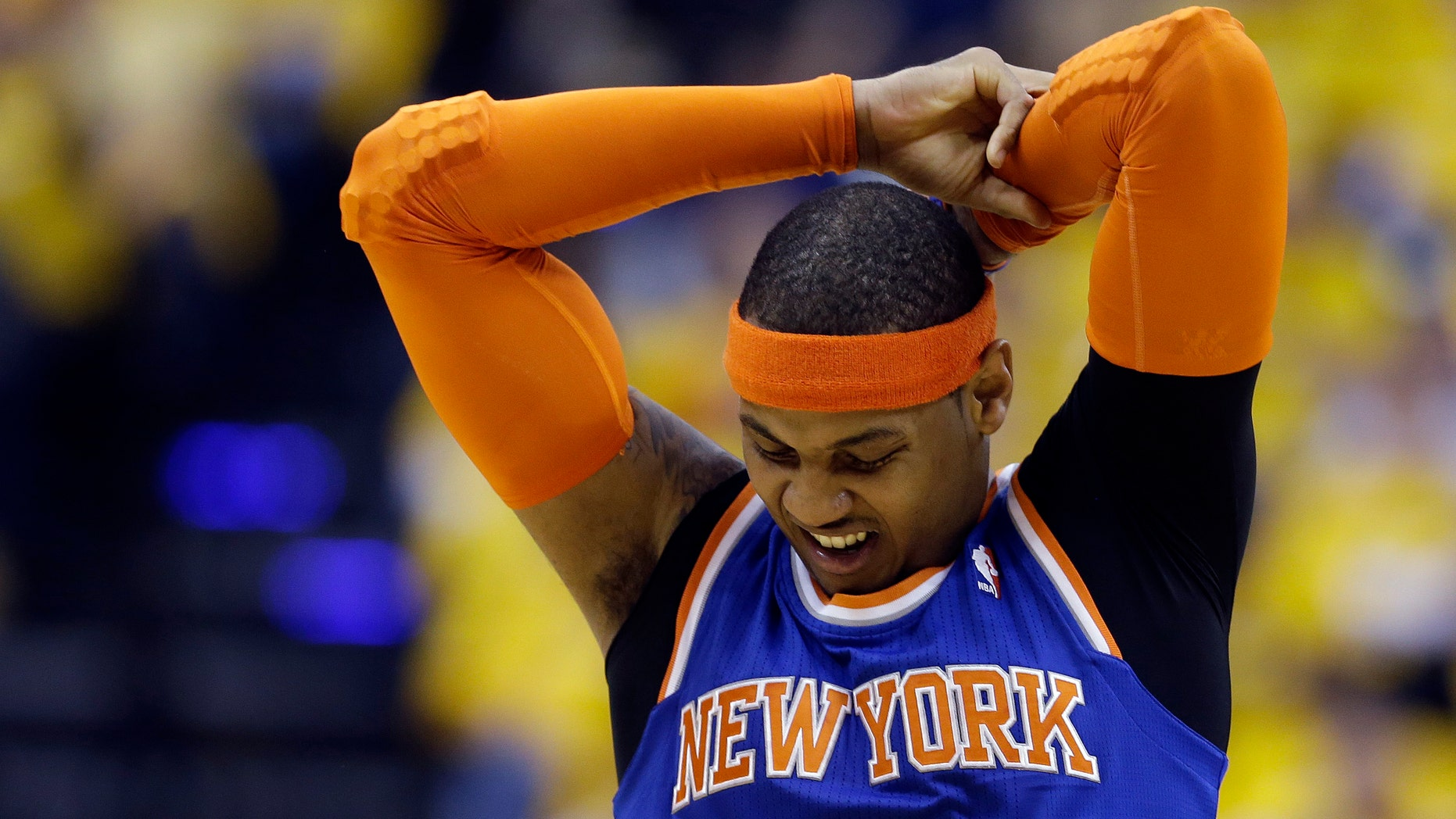 New York Knicks' Carmelo Anthony stretches during the first half of Game 3 of an Eastern Conference semifinal NBA basketball playoff series against the Indiana Pacers on Saturday, May 11, 2013, in Indianapolis. (AP Photo/Darron Cummings)