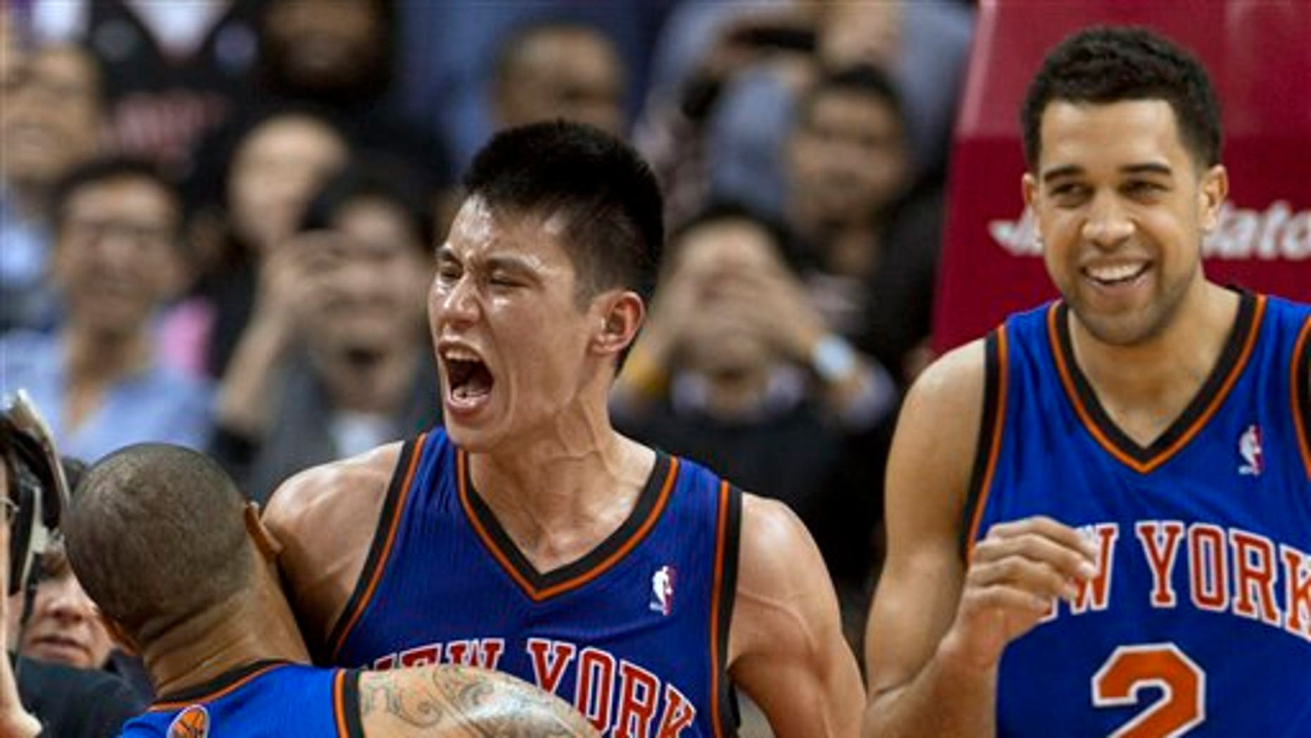 Feb. 14: New York Knicks guard Jeremy Lin (17) celebrates with teammates Tyson Chandler and Landry Fields (2) after his game-winning 3-pointer against the Toronto Raptors in an NBA basketball game in Toronto.