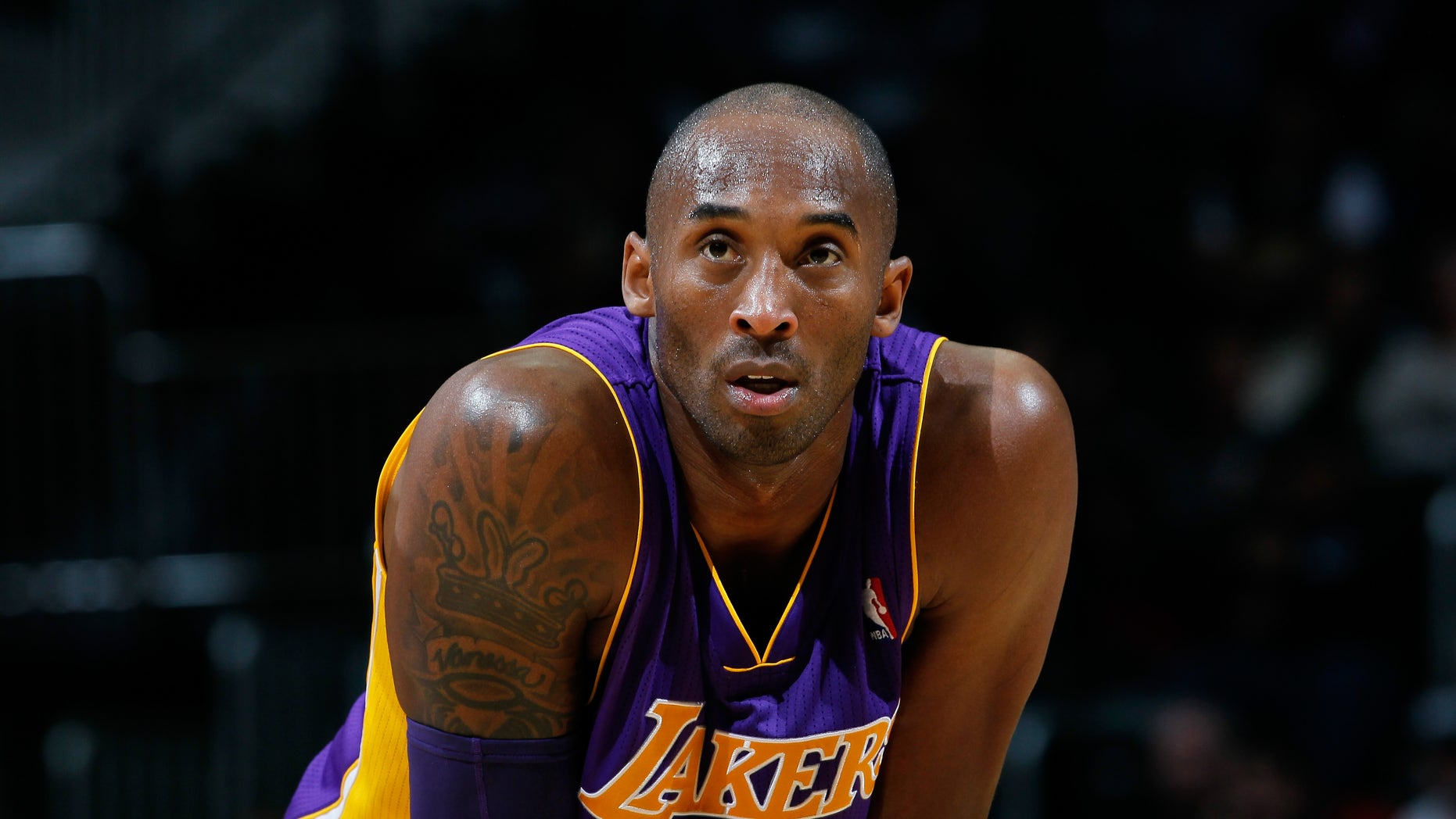 ATLANTA, GA - DECEMBER 16:  Kobe Bryant #24 of the Los Angeles Lakers stands during a free throw against the Atlanta Hawks at Philips Arena on December 16, 2013 in Atlanta, Georgia.  NOTE TO USER: User expressly acknowledges and agrees that, by downloading and or using this photograph, User is consenting to the terms and conditions of the Getty Images License Agreement.  (Photo by Kevin C. Cox/Getty Images)