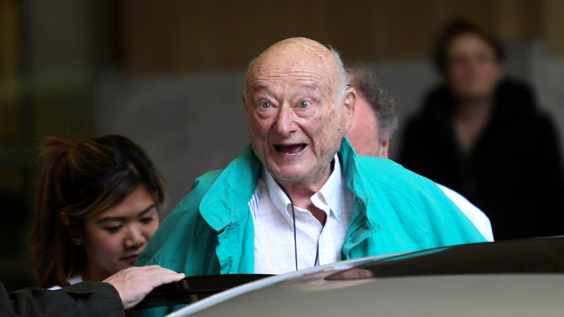 Dec. 10, 2012: In this file photo, former New York City Mayor Ed Koch says good-bye to reporters as he gets in his car after being released from the hospital in New York.