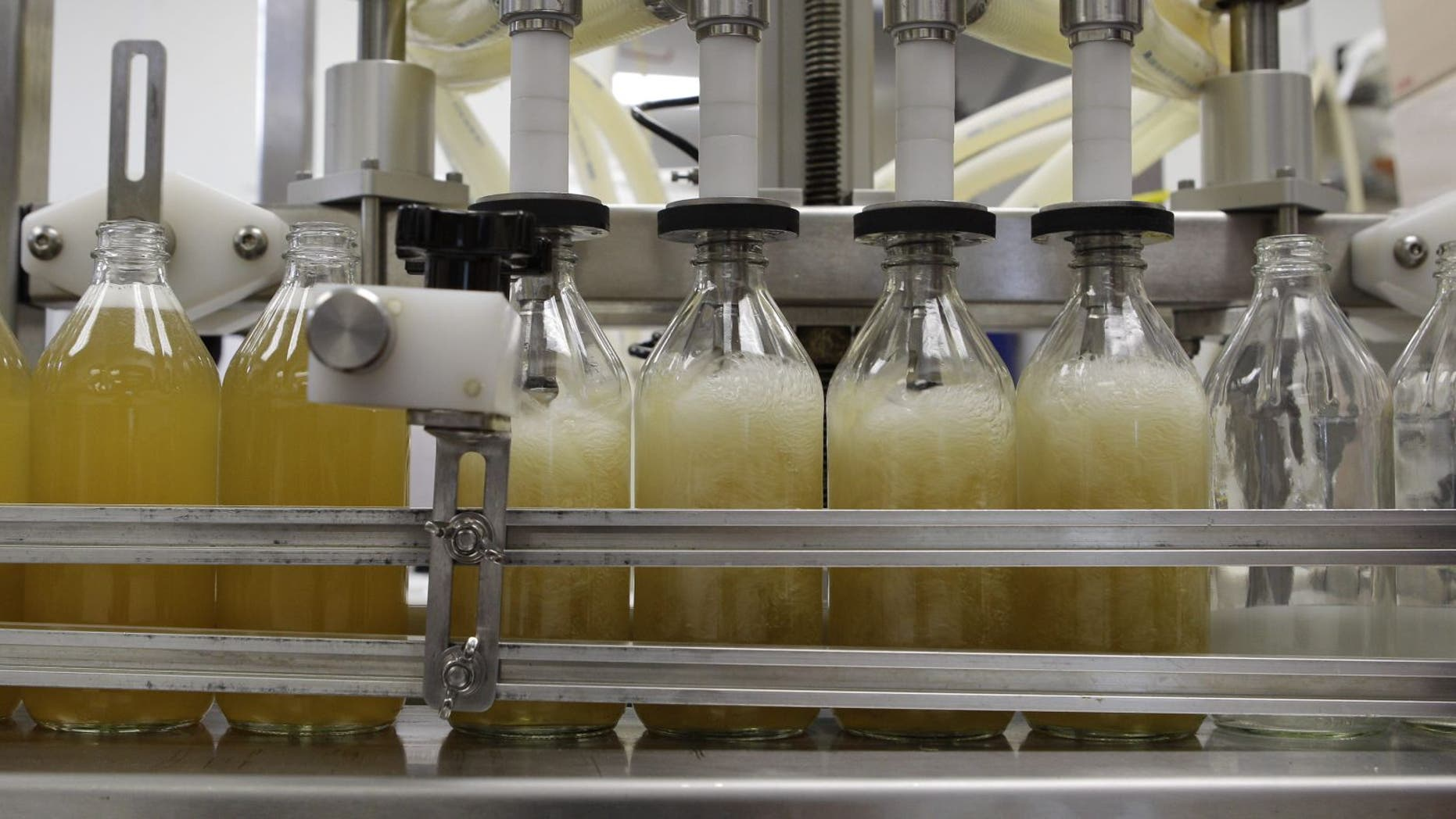Regulators and retailers are concerned that kombucha may need to be regulated as an alcoholic drink. (AP Photo/Charles Krupa)