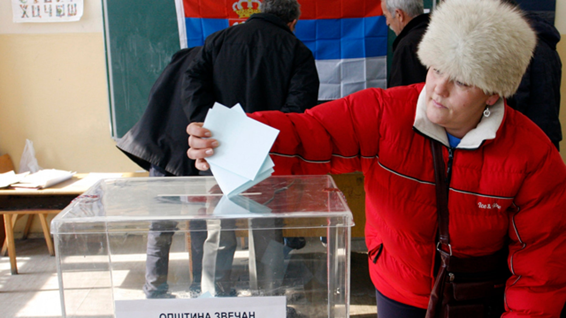 Feb. 14, 2012- A woman casts his ballot at the poilling station in Zvecan, Kosovo. Defiant Serbs in northern Kosovo voted Tuesday in a referendum that is likely to overwhelmingly reject Kosovo's ethnic Albanian rule, further hindering Serbia's attempts to join the European Union.