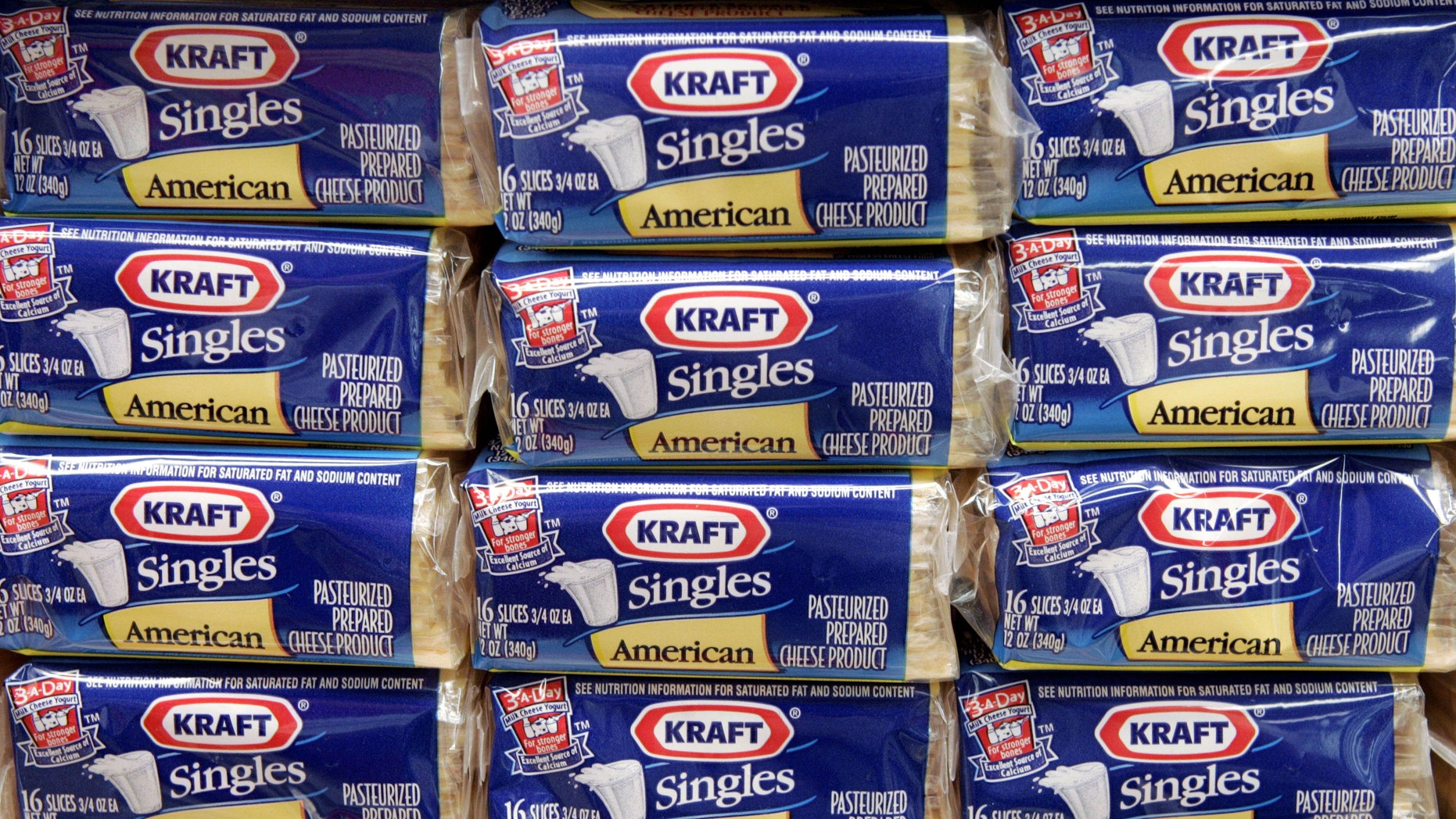 Packages of Kraft Singles are displayed in Chicago. (AP Photo/Charles Rex Arbogast, file)
