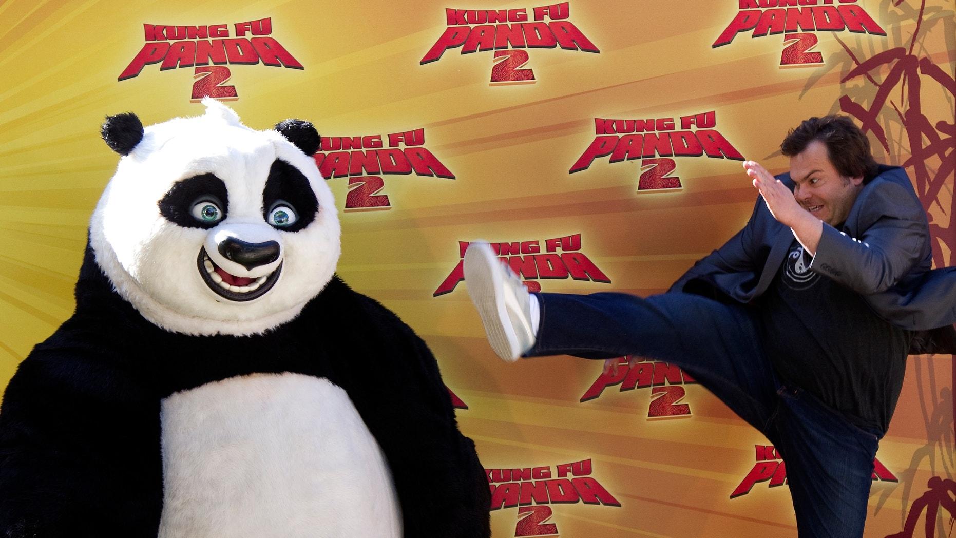"Jack Black poses with ""Kung Fu Panda"""