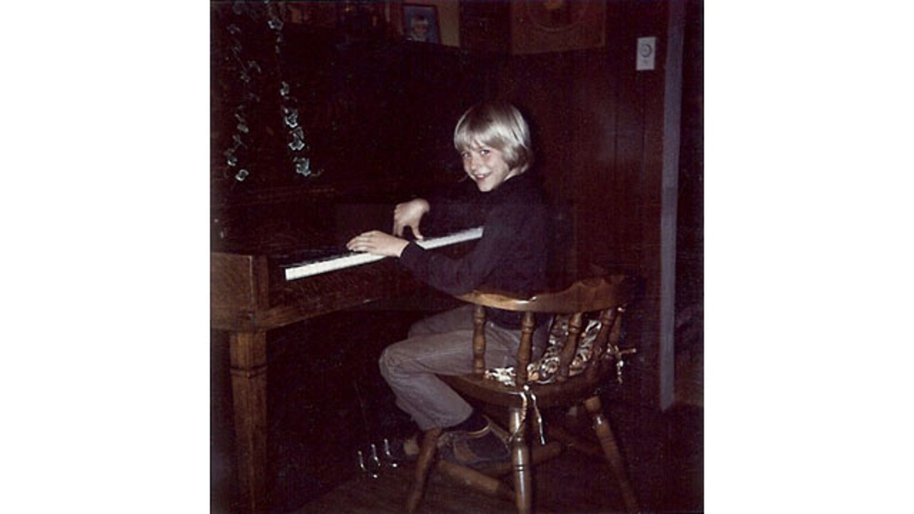September 24, 2013: In this undated photo provided by Kim Cobain, a young Kurt Cobain plays piano in his childhood home in Aberdeen, Wash. Cobain's mother, Wendy O'Connor, is putting the 1.5-story Aberdeen bungalow, which is assessed at less than $67,000,  on the market for $500,000. But she'd also be happy entering into a partnership with anyone who wants to turn it into a museum. (AP Photo)