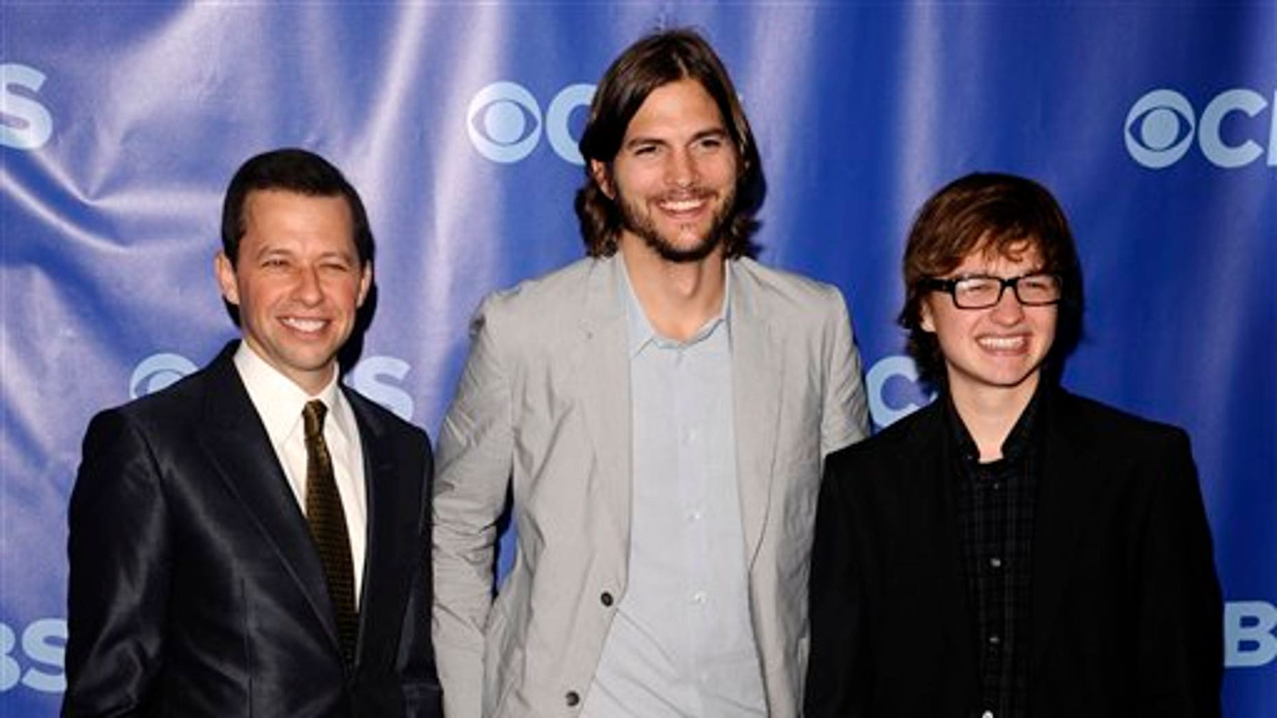 In this May 18, 2011 file photo, actors, from left, Jon Cryer, Ashton Kutcher and Angus T. Jones attend the 2011 CBS Upfront party in New York. (AP)