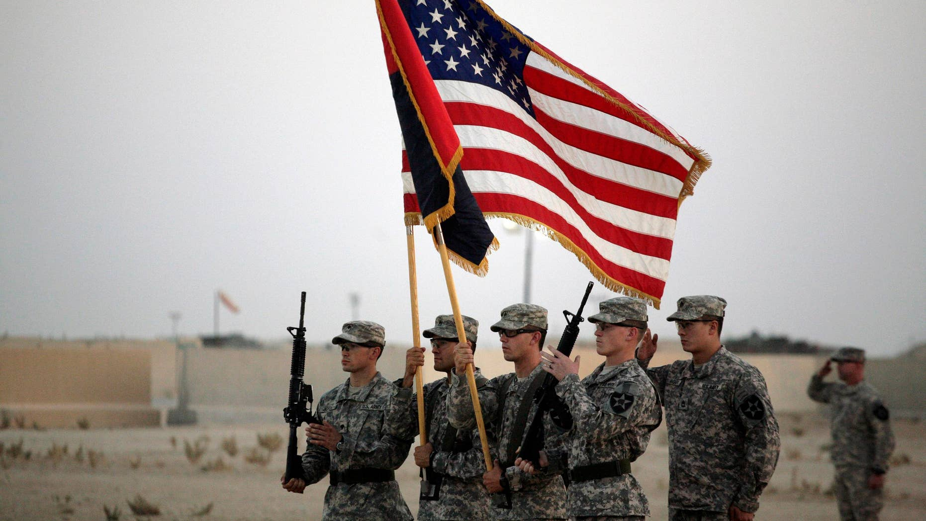 U.S. Army soldiers take part in the casing ceremony on Aug. 21 for the last American combat brigade to serve in Iraq as a small army of American diplomats is left behind to keeping the volatile country from slipping back to the brink of civil war.(AP)