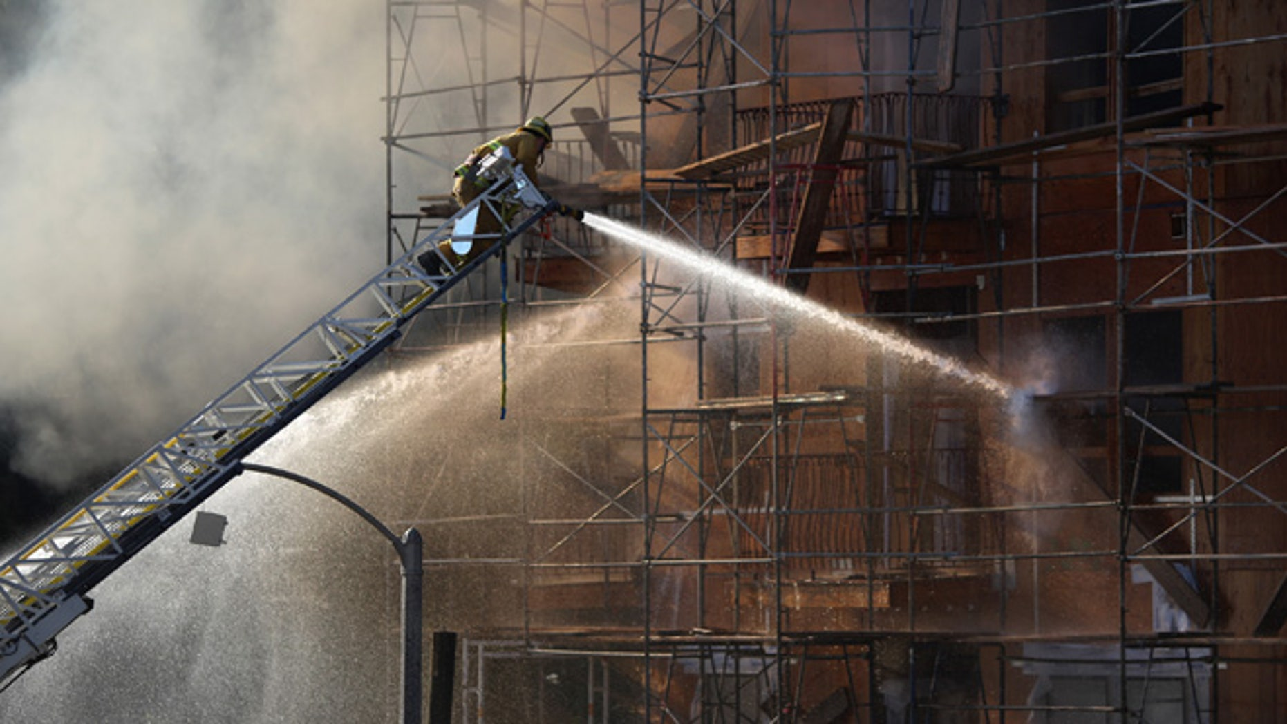 Firefighters battle a fire that destroyed a seven-story apartment building under construction on December 8, 2014 in Los Angeles, California.  (Photo by David McNew/Getty Images)
