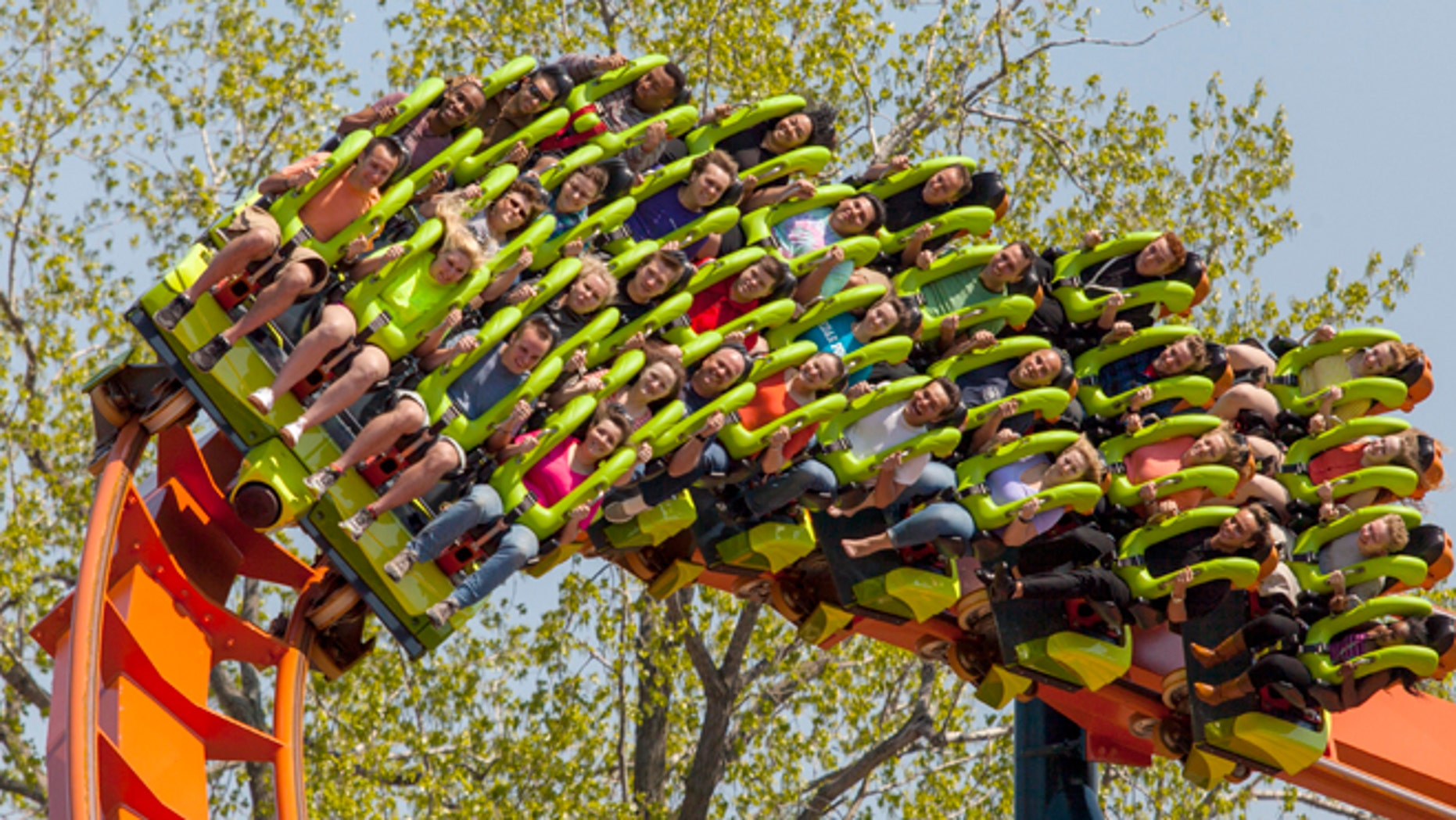 This photo provided by Cedar Point in Sandusky, Ohio, shows the theme park's new Rougarou roller coaster. The floorless coaster has a werewolf theme. It's one of a number of new attractions at theme parks around the country this summer. (AP Photo/Cedar Point)
