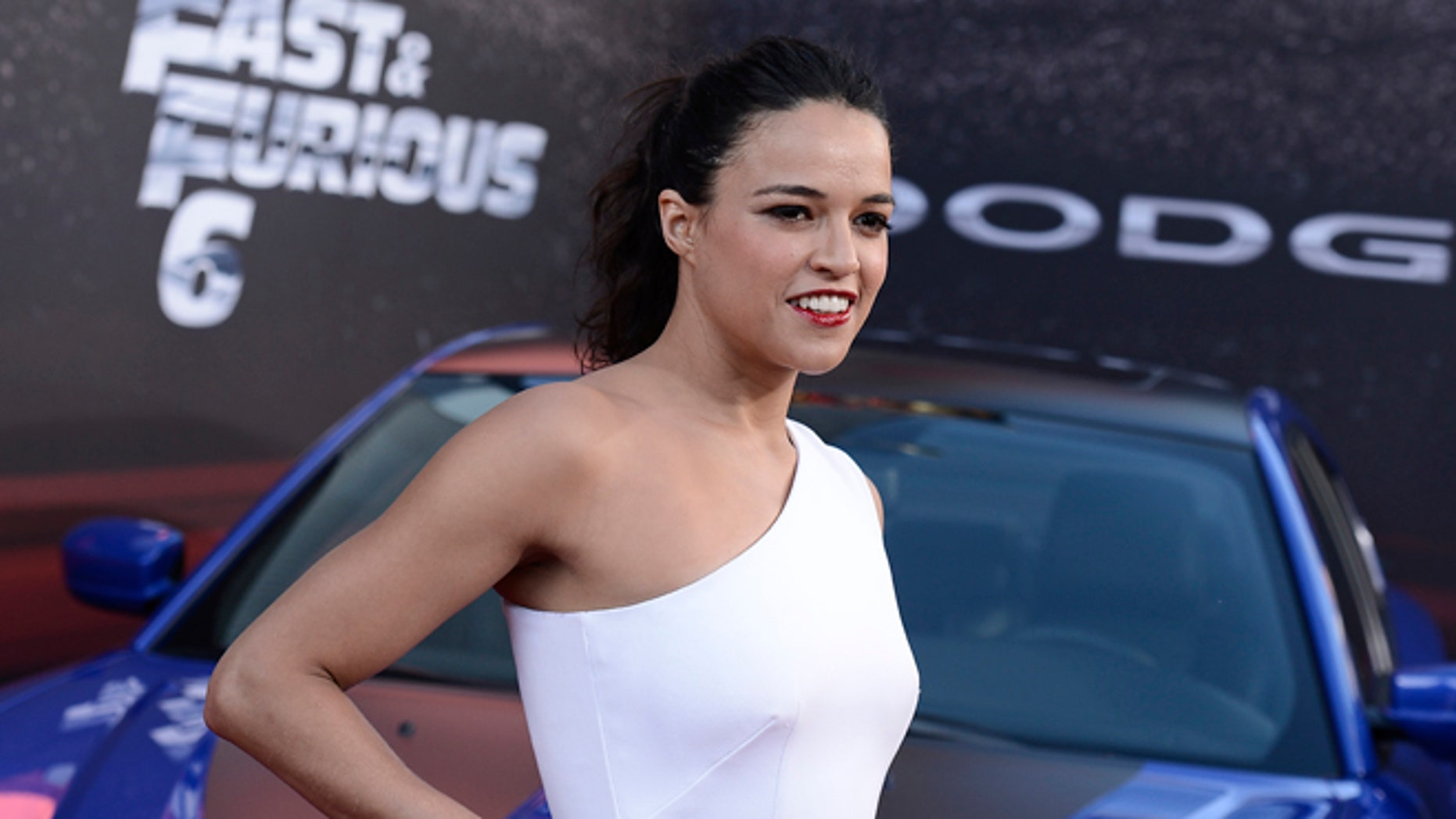 """Actress Michelle Rodriguez arrives at the LA Premiere of the """"Fast & Furious 6"""" at the Gibson Amphitheatre on Tuesday, May 21, 2013 in Universal City, Calif. (Photo by Dan Steinberg/Invision/AP)"""