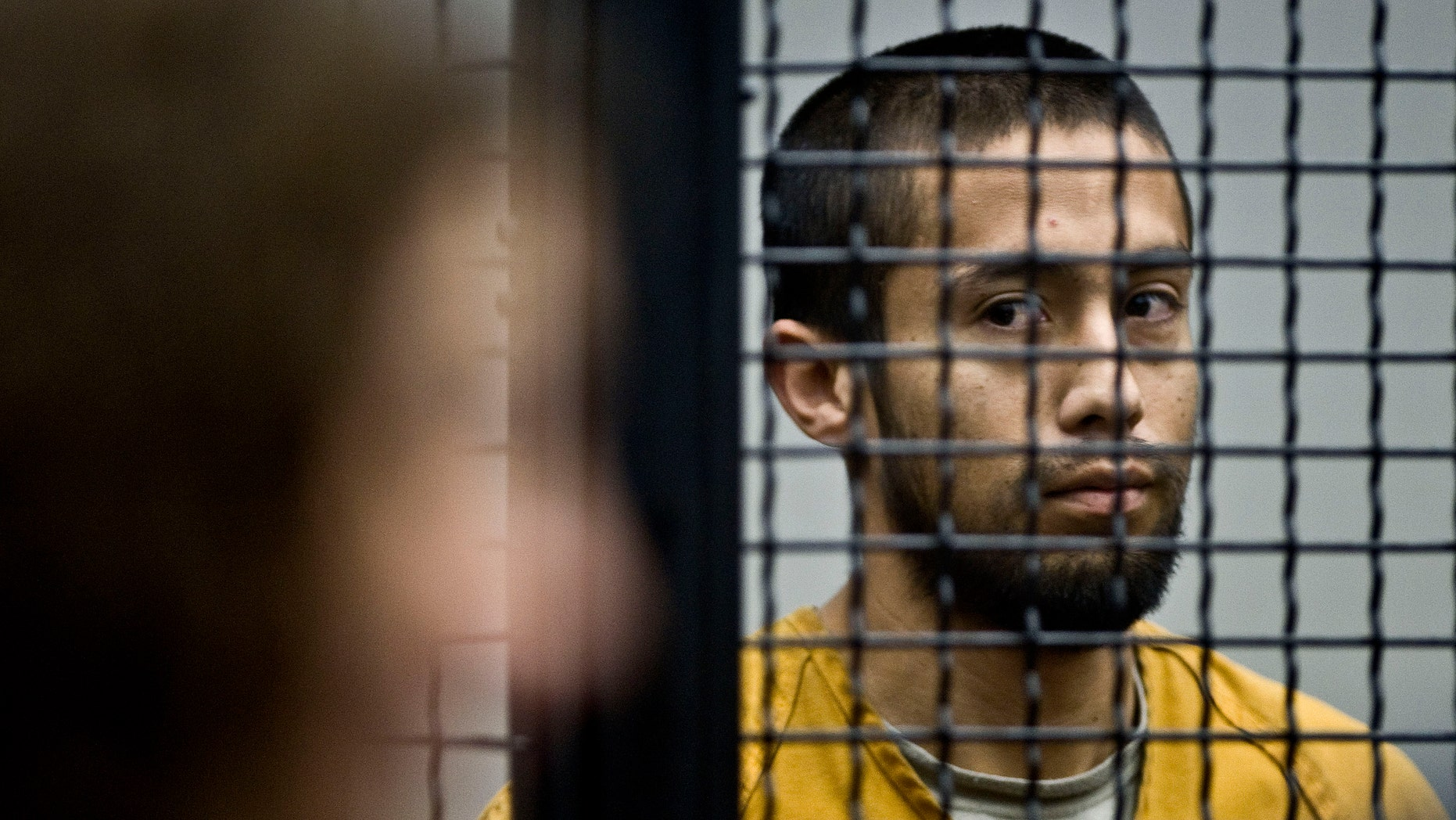 At the end of his arraignment hearing, Iztcoatl Ocampo, is seen in court, in Santa Ana, Calif., Monday, Feb. 6, 2012. (AP Photo/Orange County Register, Bruce Chambers, Pool)