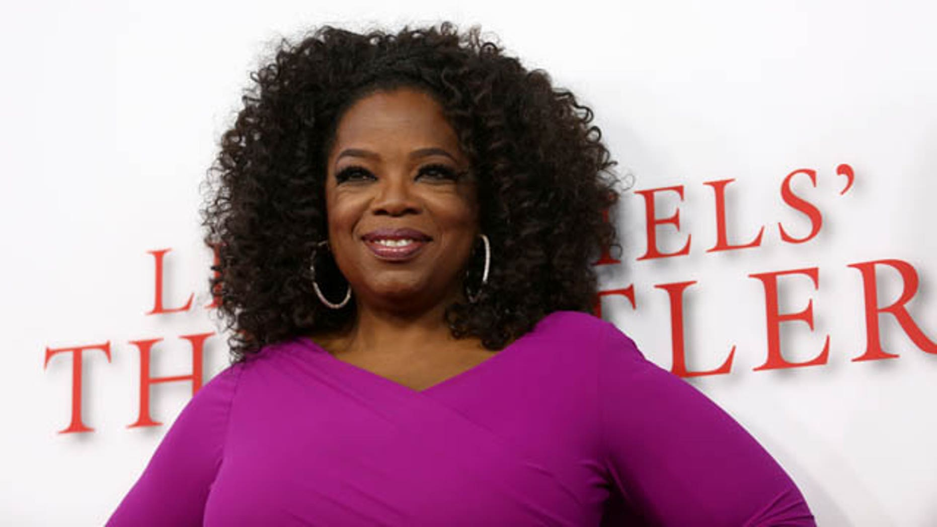 "August 12, 2013: Oprah Winfrey arrives at the Los Angeles premiere of ""Lee Daniels' The Butler"" at the Regal Cinemas L.A. Live Stadium 14. (Photo by Matt Sayles)"