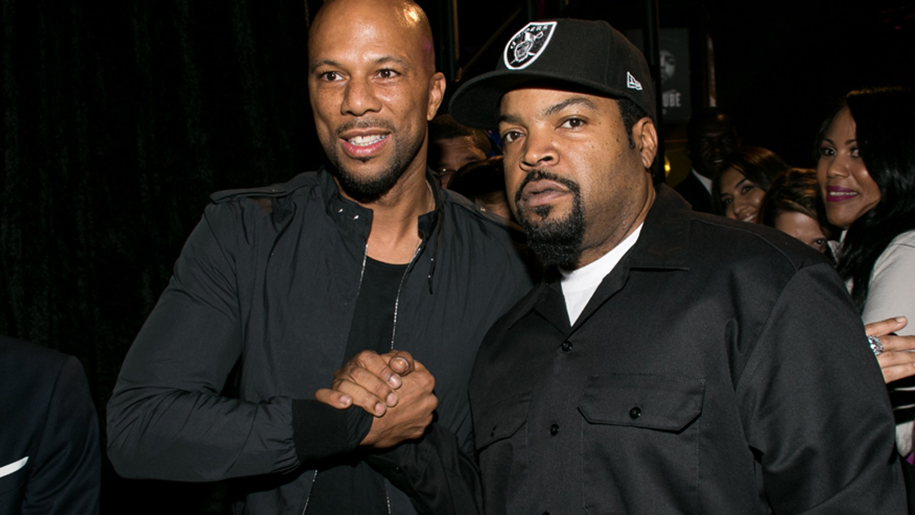 """Common, left, and Ice Cube attend the Los Angeles premiere of """"Straight Outta Compton"""" after party at the L.A. Live Event Deck on Monday, Aug. 10, 2015."""