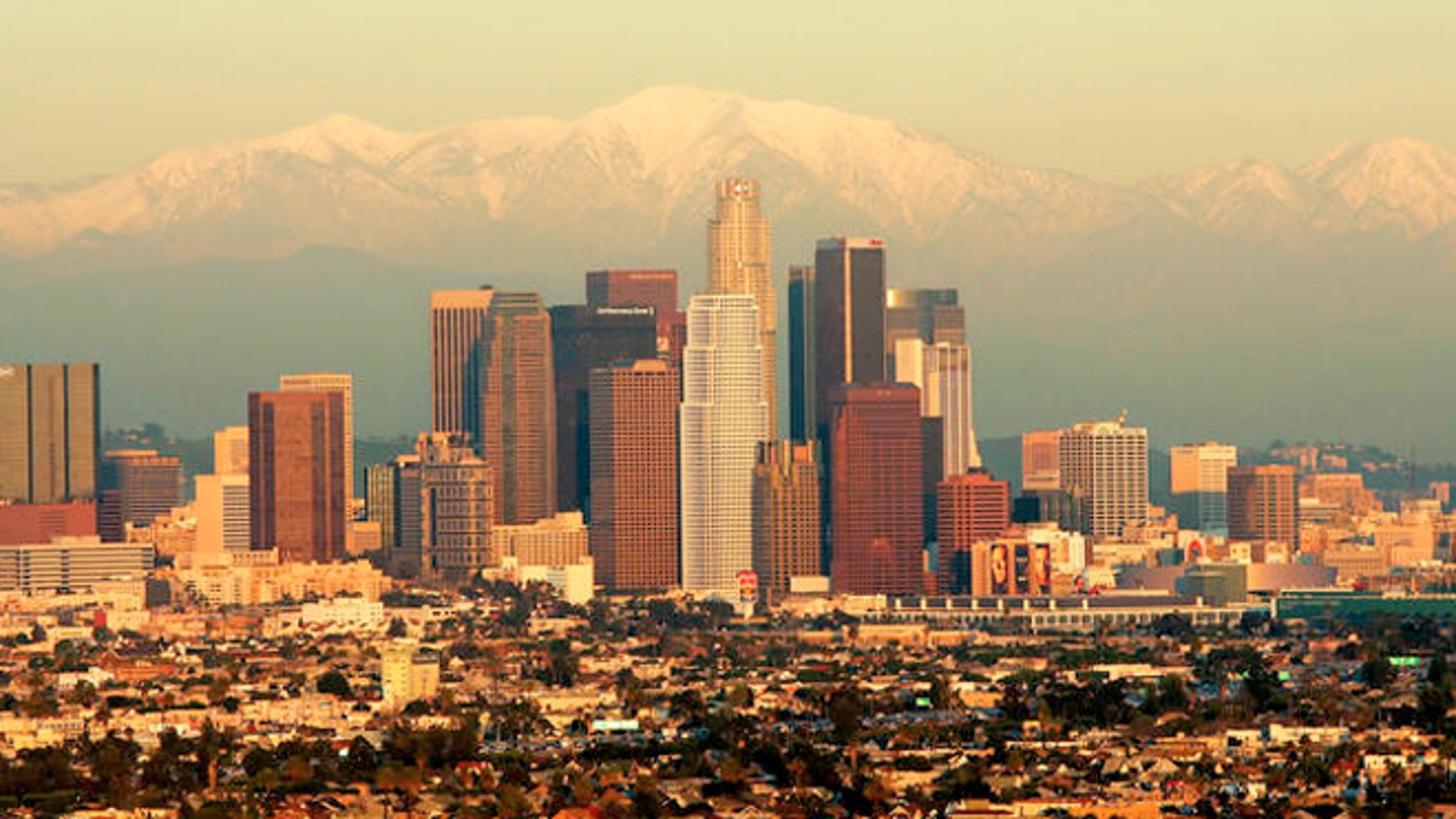 The downtown Los Angeles skyline with snow capped San Gabriel mountain range is seen here from a helecopter over the Baldwin Hills area of Los Angeles, Wednesday, Jan. 12, 2005.   (AP Photo/Mark J. Terrill)