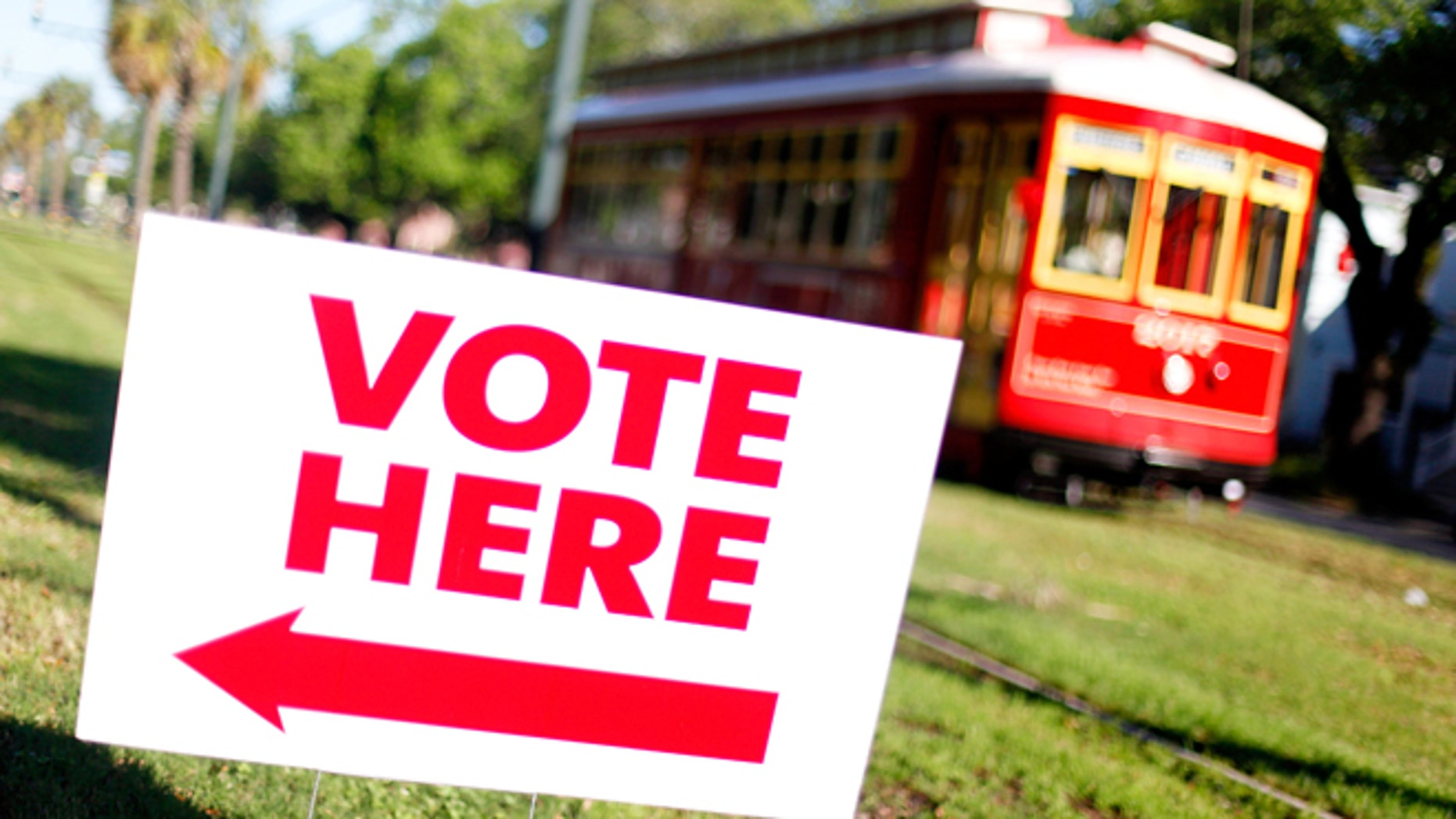 NEW ORLEANS, LA - MARCH 24:  A street car pases a voting station along St. Charles Avenue during the state Republican primary on March 24, 2012 in New Orleans, Louisiana. Voters go the polls to pick a candidate with 20 delegates up for grabs.  (Photo by Sean Gardner/Getty Images)