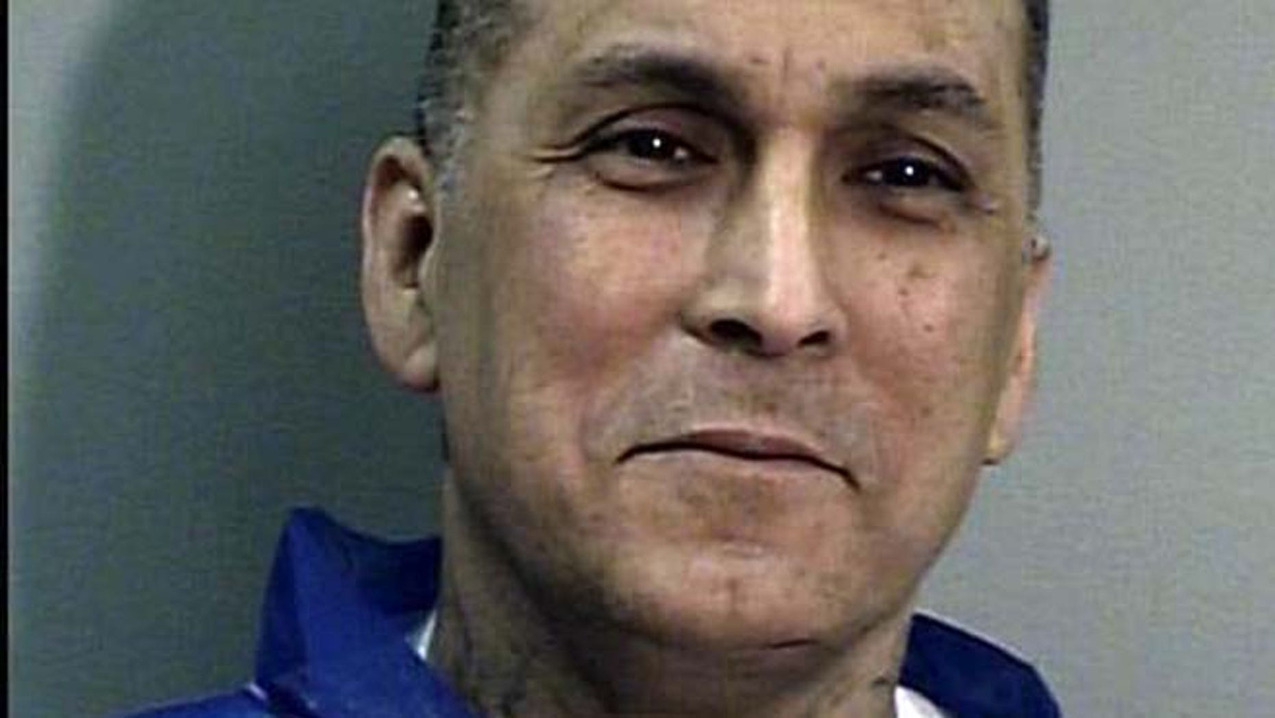 """This undated file photo from the California Department of Corrections and Rehabilitation shows Rene """"Boxer"""" Enriquez. The Los Angeles Police Department used an invalid court order and spent $22,000 to bring the imprisoned killer and former gang leader to speak to an exclusive dinner for private executives, according to a report released Friday."""