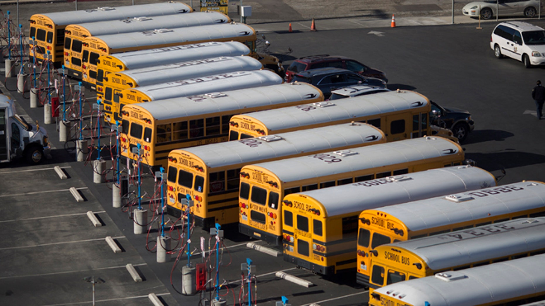 School buses stand idle as all Los Angeles city schools are shut down in reaction to a threat on December 15, 2015 in Los Angeles, California. (Photo by David McNew/Getty Images)