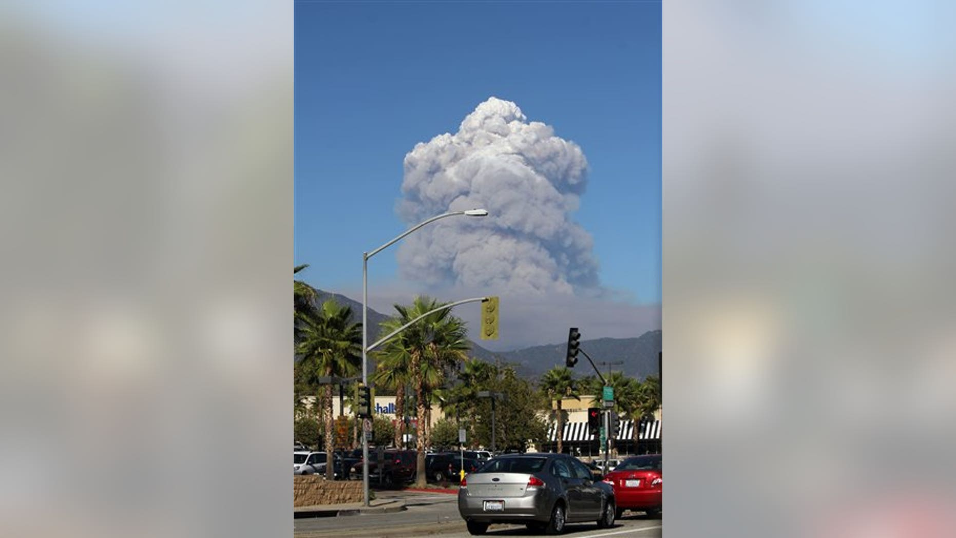 Sept, 2, 2012: A plume of smoke rises from the San Gabriel Canyon area of the Angeles National Forest in the San Gabriel Mountains northeast of Los Angeles.