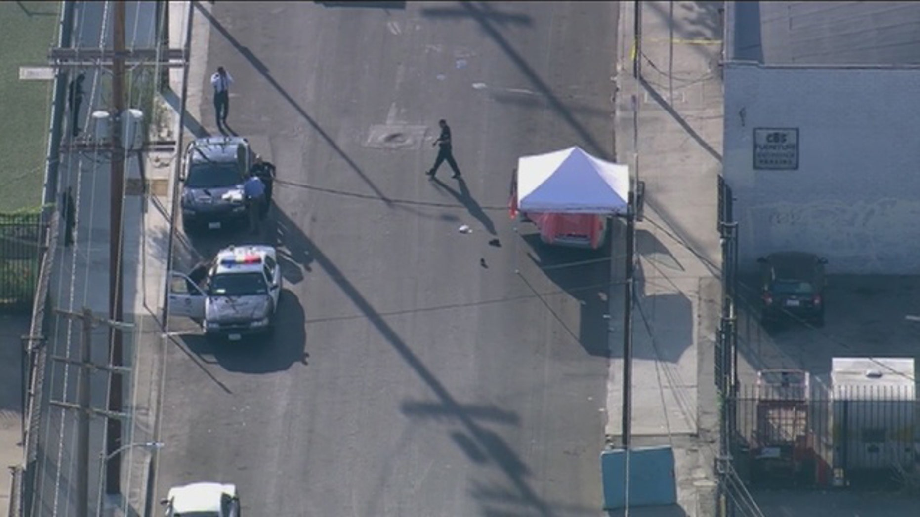Sept. 9, 2015: Los Angeles police investigate the scene of a triple homicide in which three boys between the ages of 8 and 12 were stabbed to death. (KTTV)