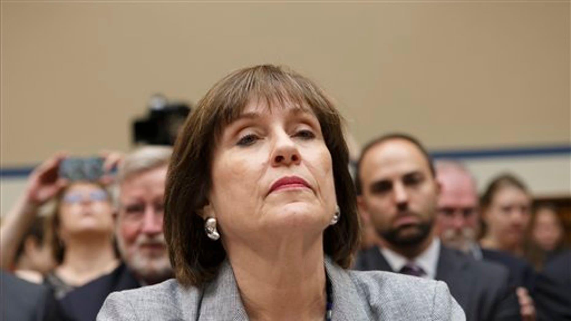 FILE - In this May 22, 2013 file photo, Internal Revenue Service official Lois Lerner listens during a House Oversight Committee hearing on Capitol Hill in Washington.(AP Photo/J. Scott Applewhite, File)