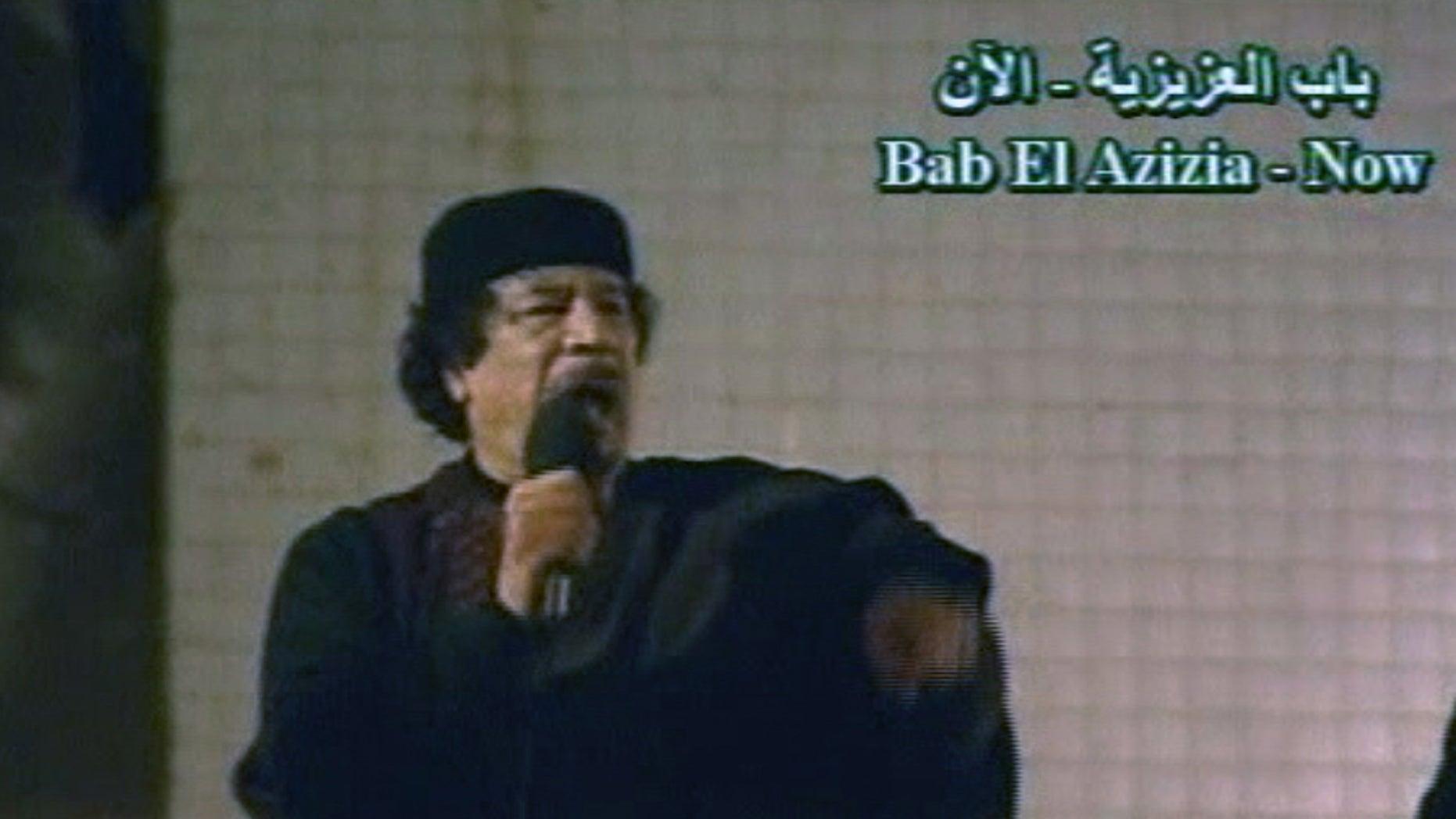 March 22: In this image taken from Libyan State TV, Libyan leader Muammar Qaddafi talks to a large crowd in Bab El Azizia, Libya. (AP)