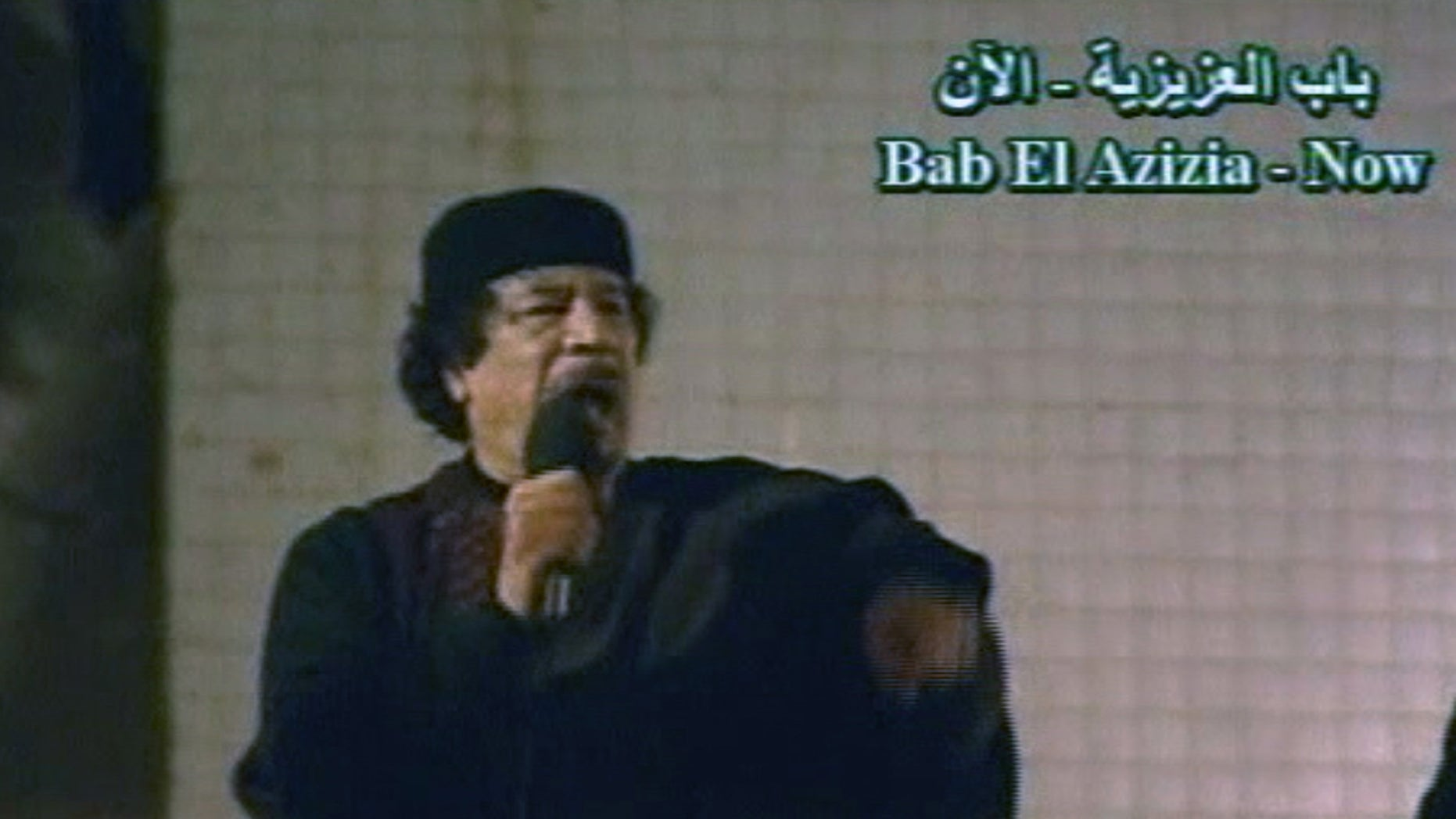 March 22: In this image taken from Libyan State TV, Libyan leader Muammar Qaddafi talks to a large crowd in Bab El Azizia, Libya. (AP)