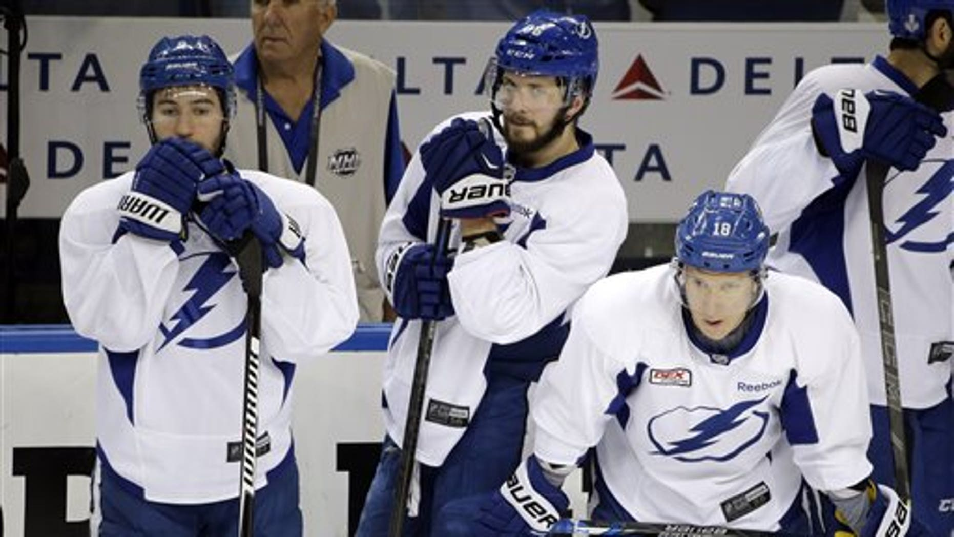 Tampa Bay Lightning players, from left, Tyler Johnson, Nikita Kucherov, and Ondrej Palat, also known as the triplets, watch drills during NHL hockey practice at Amalie Arena for the Stanley Cup Finals, Tuesday, June 2, 2015, in Tampa, Fla. (AP Photo/Chris O'Meara)