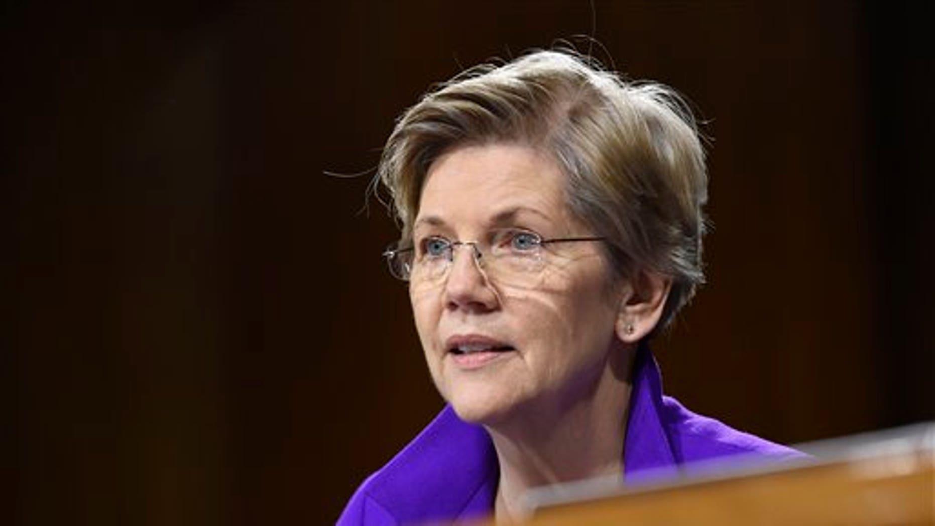FILE - In this Feb. 24, 2015, file photo, Sen. Elizabeth Warren, D-Mass., is seen on Capitol Hill in Washington. (AP Photo/Susan Walsh, File)